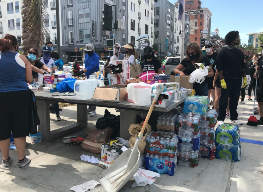 Volunteers help with cleanup after protests in Long Beach on June 1, 2020. (Los Angeles Times)