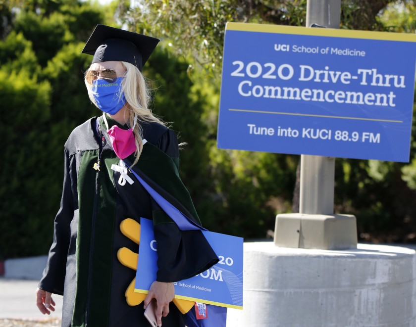 UC Irvine Associate Dean for Students Megan Osborn wore a mask to a drive-through commencement ceremony in May 2020. (Raul Roa / Daily Pilot)