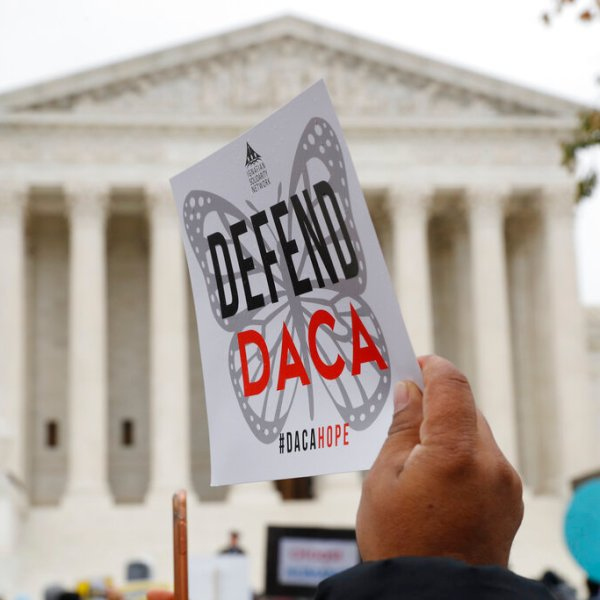 In this Nov. 12, 2019, file photo people rally outside the Supreme Court as oral arguments are heard in the case of President Trump's decision to end the Obama-era, Deferred Action for Childhood Arrivals program (DACA), at the Supreme Court in Washington. (AP Photo/Jacquelyn Martin, File)