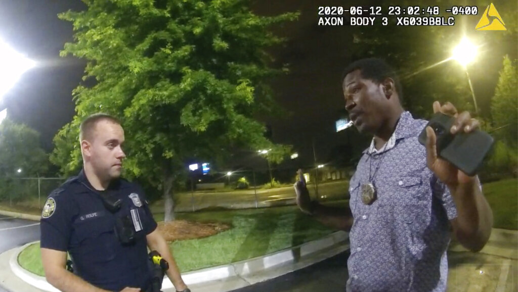 This screen grab taken from body camera video provided by the Atlanta Police Department shows Rayshard Brooks speaking with Officer Garrett Rolfe in the parking lot of a Wendy's restaurant in Atlanta on June 12, 2020.