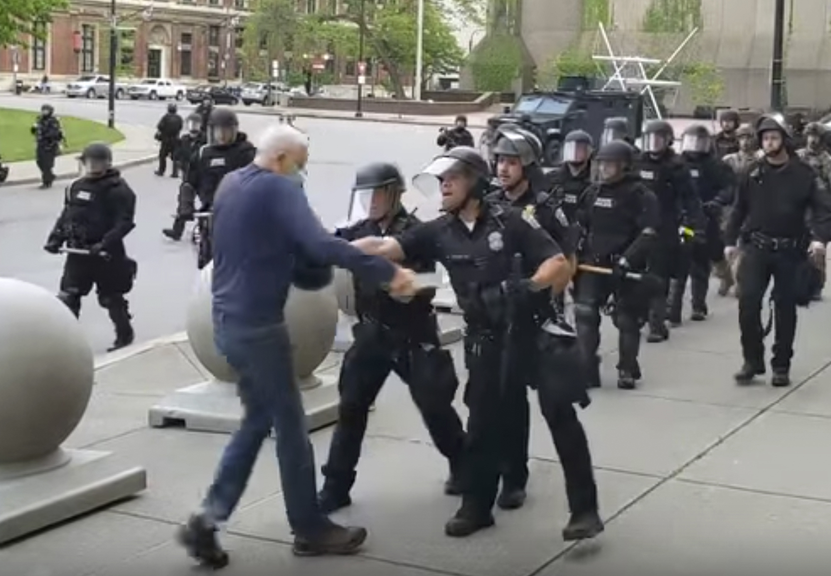 In this image from video provided by WBFO, a police officer appears to shove a man who walked up to police June 4, 2020, in Buffalo, New York.