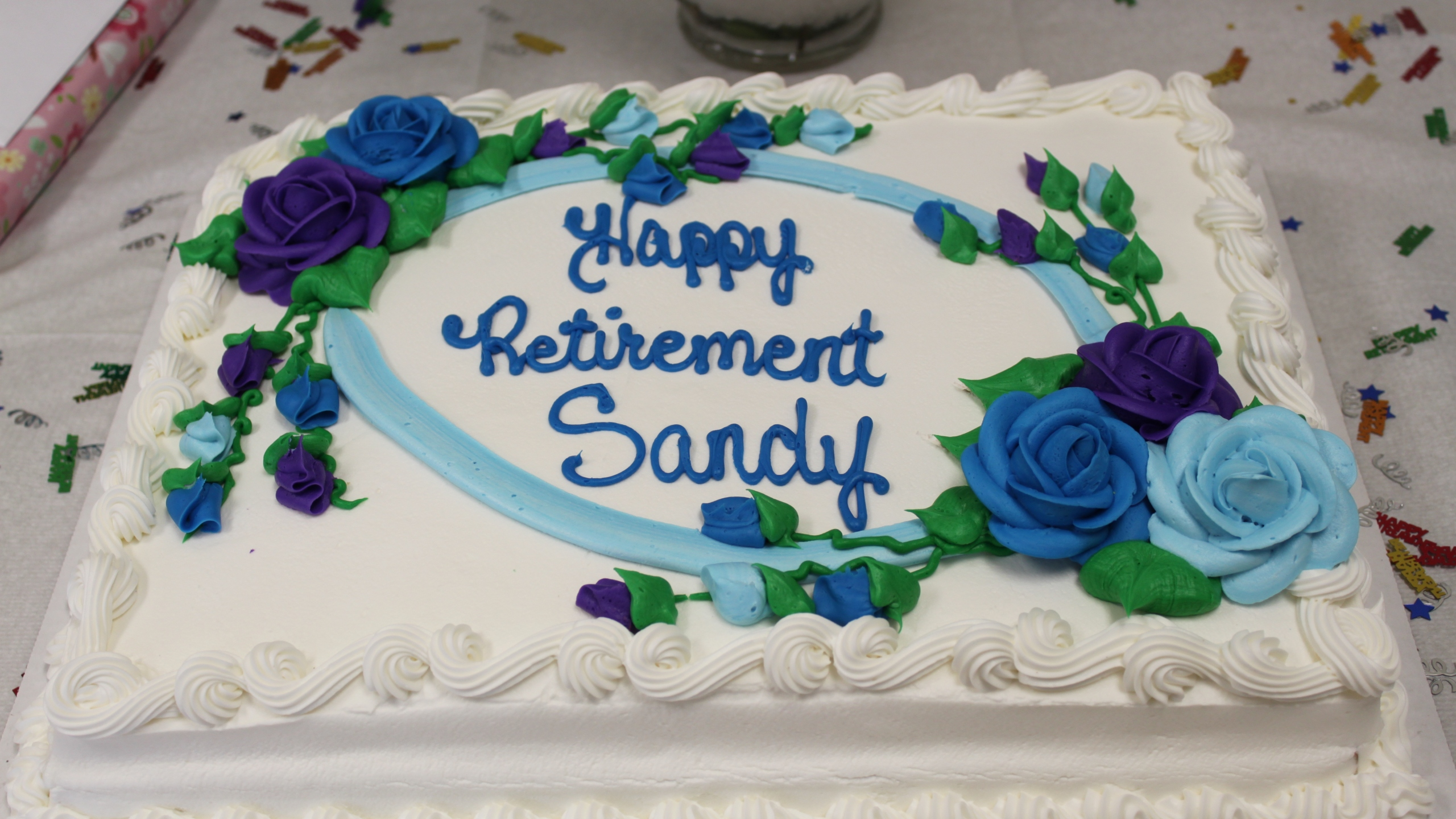"A cake from Costco reads ""Happy Retirement Sandy"" in a 20013 photo from Minnesota's Anoka County Library Flickr page."