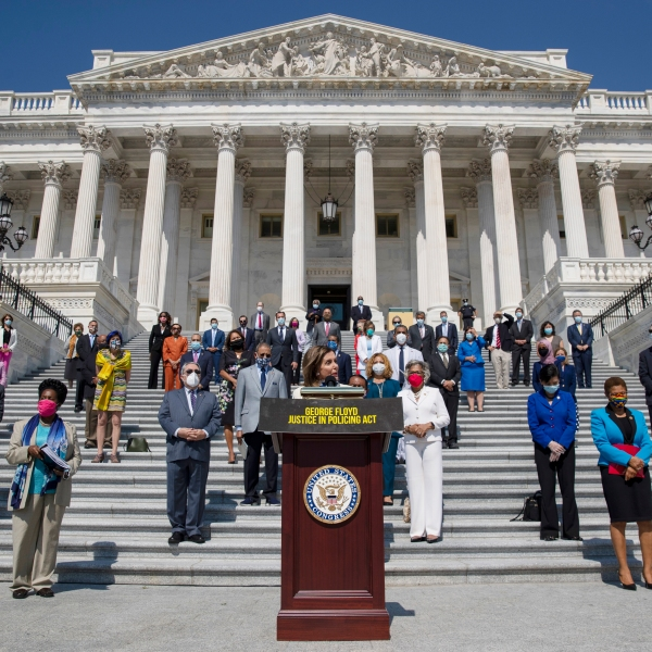 House Speaker Nancy Pelosi, joined by House Democrats spaced for social distancing, speaks during a news conference on the House East Front Steps on Capitol Hill, June 25, 2020. (AP Photo / Carolyn Kaster)