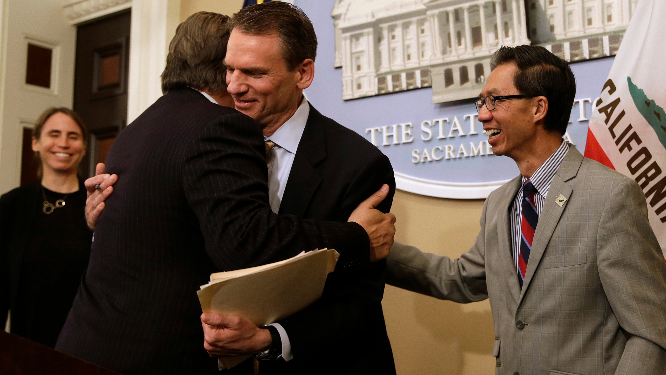 In this June 28, 2018, file photo, state Sen. Bob Hertzberg, D-Van Nuys, left, and Assemblyman Ed Chau, D-Arcadia, right, celebrate with Alastair Mactaggart, center, after the Legislature approved their data privacy bill in Sacramento. (AP / Rich Pedroncelli)