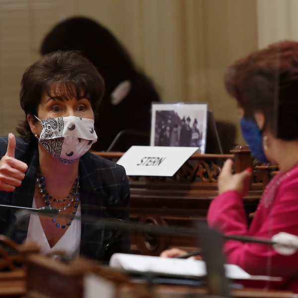 State Sen. Connie Leyva, D-Chino, left, gives a thumbs up as she talks with Sen. Anna Caballero, D-Salinas, at the Capitol, in Sacramento on June 25, 2020. (AP Photo/Rich Pedroncelli)
