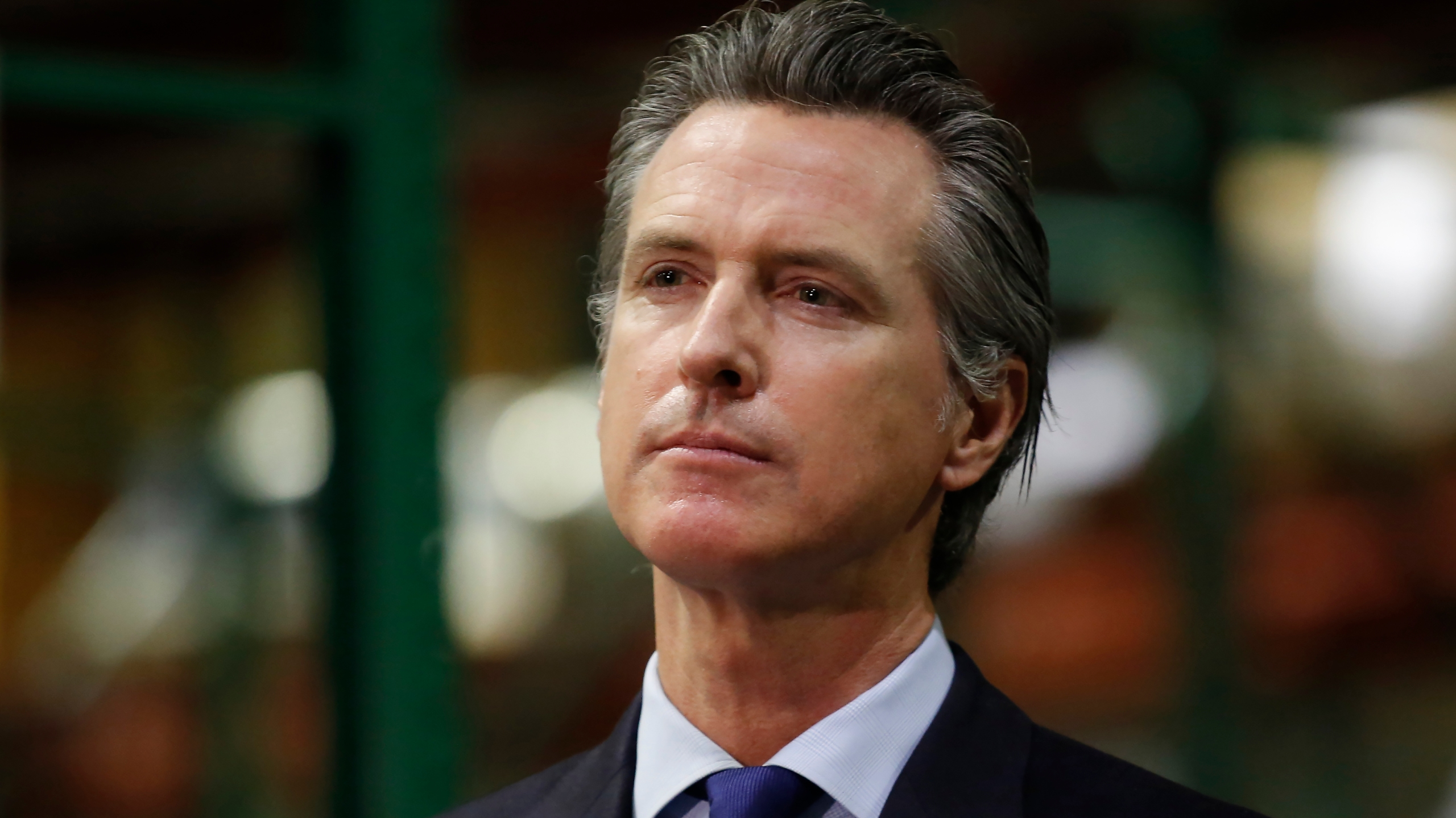 Gov. Gavin Newsom listens to a reporter's question during a news conference in Rancho Cordova on June 26, 2020. (Rich Pedroncelli / AP)