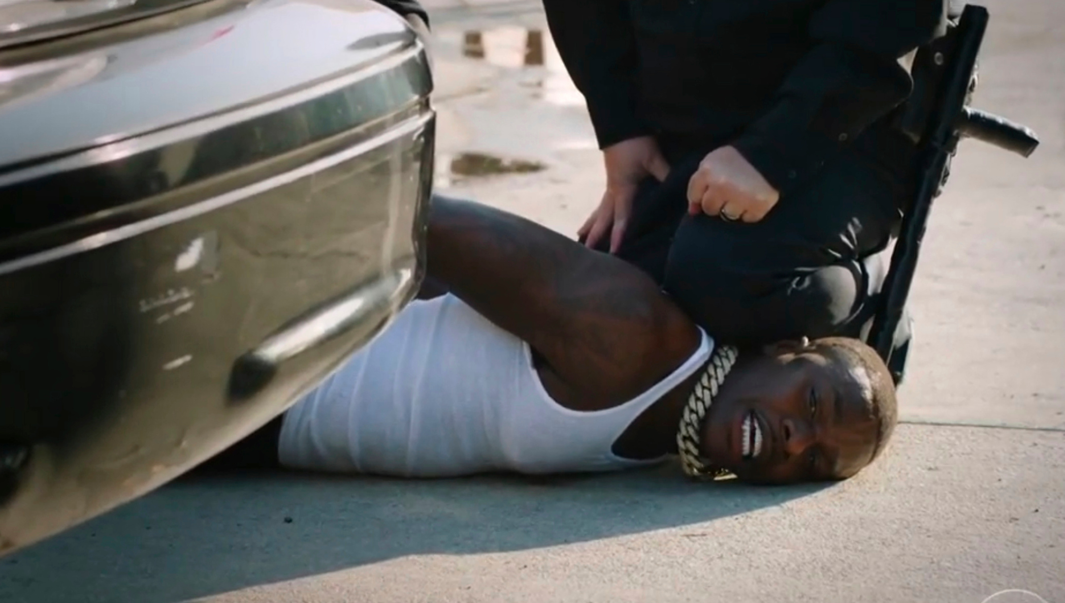 "In this video grab issued Sunday, June 28, 2020, by BET, rapper DaBaby performs ""Rockstar"" as an actor playing a police officer presses his knee on DaBaby's neck, replicating the last few moments of George Floyd's life, during the BET Awards. (BET via AP)"