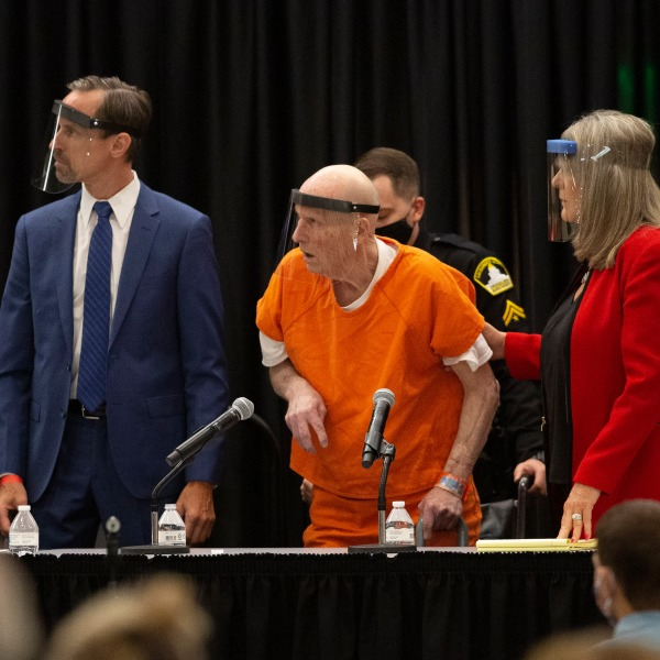 Joseph James DeAngelo, center, charged with being the Golden State Killer, his helped up by his attorney, Diane Howard, as Sacramento Superior Court Judge Michael Bowman enters the courtroom in Sacramento on June 29, 2020. (Rich Pedroncelli/Associated Press)