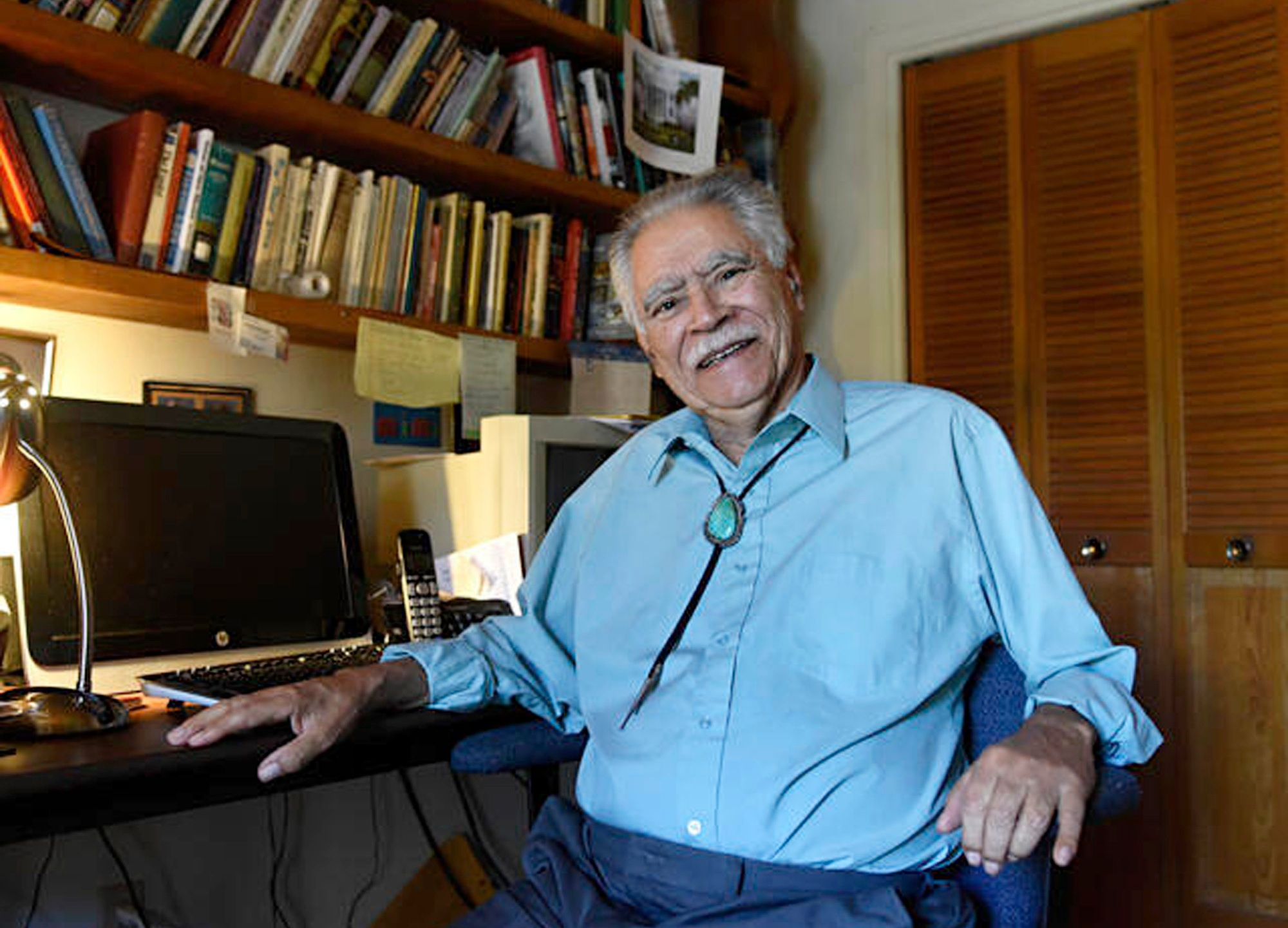 In this June 6, 2016 image, author Rudolfo Anaya poses for a photograph in his home writing studio. (Dean Hanson/Albuquerque Journal via AP)