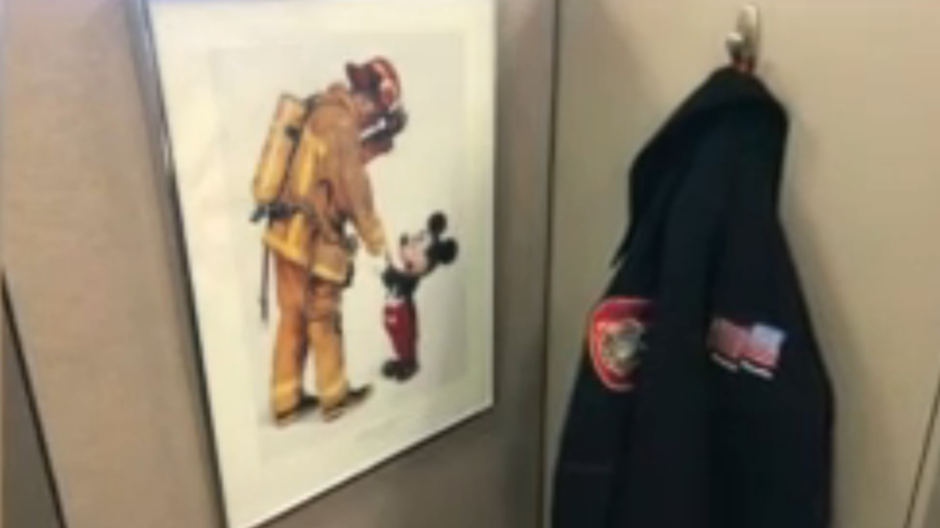 Anaheim Fire Capt. David Baker is pictured with Mickey Mouse in a 1993 photo. (City of Anaheim)