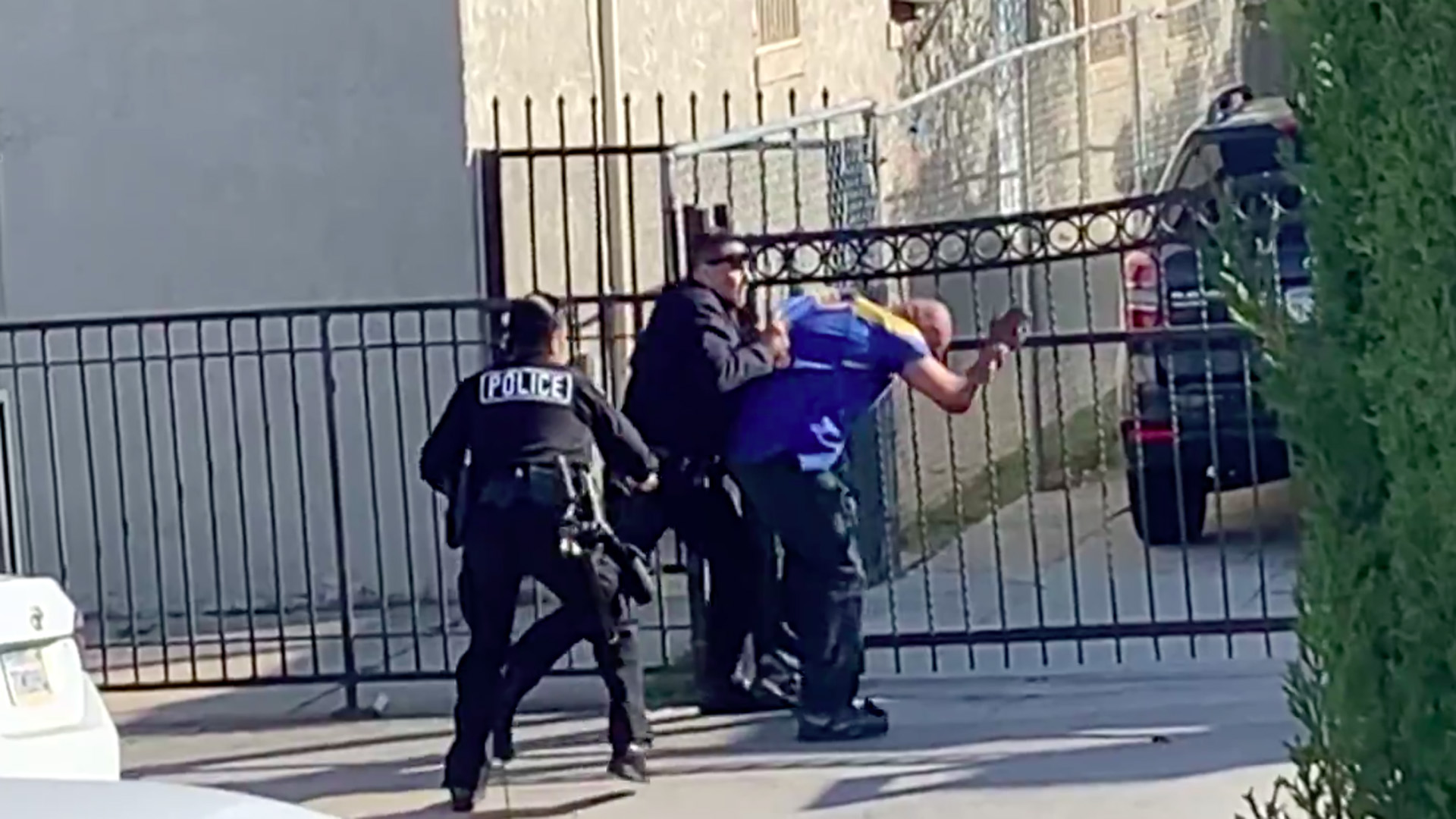 A Los Angeles Police Officer strikes a man in Boyle Heights in a still from a video provided to KTLA on April 5, 2020.