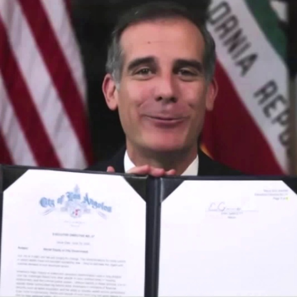 Mayor Eric Garcetti signs an executive order directing all city departments to begin planning affirmative action programs in recruitment hiring, training and personnel policies on June 19, 2020.