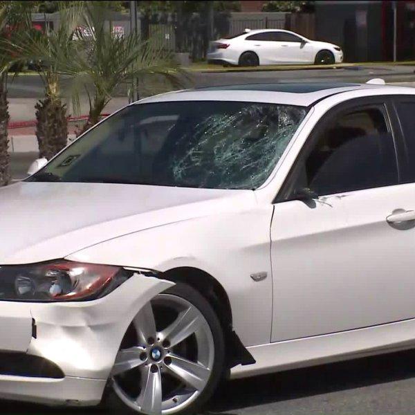 A white BMW is seen near where a pedestrian was fatally struck in Santa Ana on June 23, 2020. (KTLA)