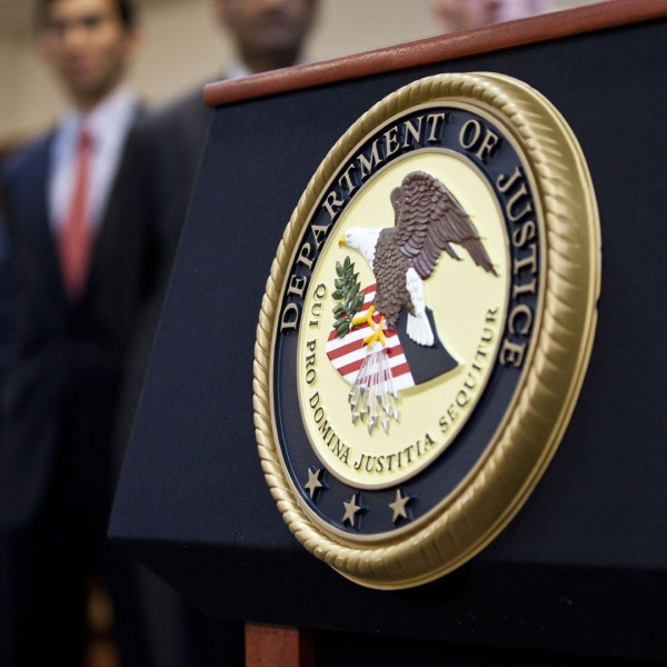 A U.S. Department of Justice seal is displayed on a podium during a news conference. (Ramin Talaie/Getty Images)