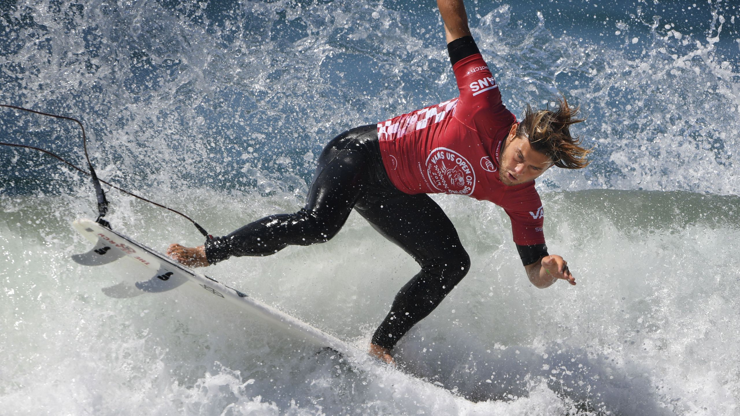 Conner Coffin of the U.S. lands after a rotation during round four of the Vans U.S. Open of Surfing held at Huntington Beach on Aug. 2, 2019. (MARK RALSTON/AFP via Getty Images)