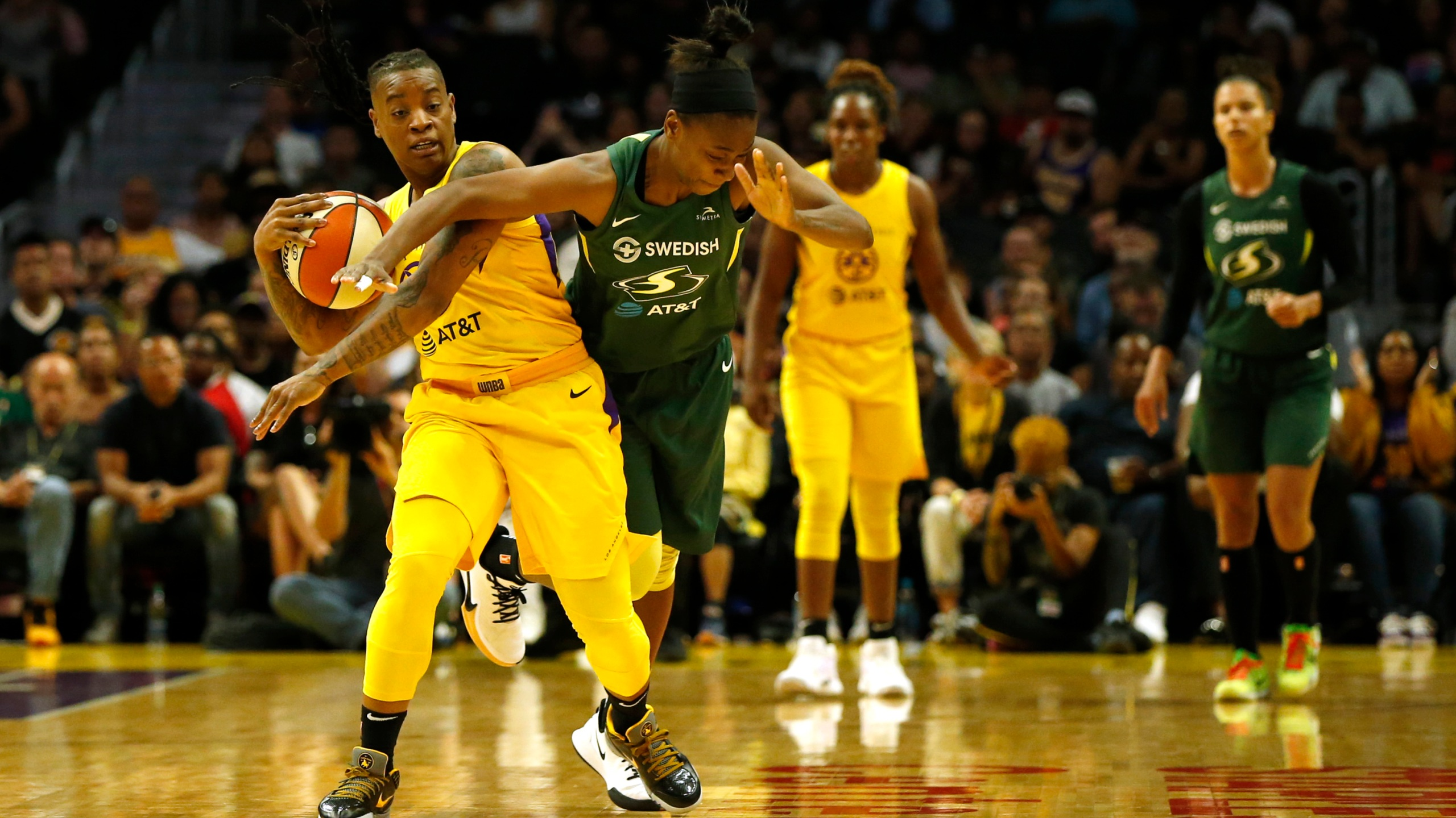 Guard Riquna Williams #2 of the Los Angeles Sparks and guard Jewell Loyd #24 of the Seattle Storm fight for a jump ball during the second half of a game at Staples Center on Sept. 15, 2019. (Katharine Lotze/Getty Images)