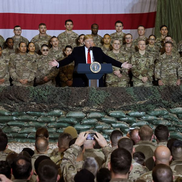 In this photo taken on Nov. 28, 2019, Donald Trump speaks to the troops during a surprise Thanksgiving Day visit at Bagram Air Field in Afghanistan. (OLIVIER DOULIERY/AFP via Getty Images)