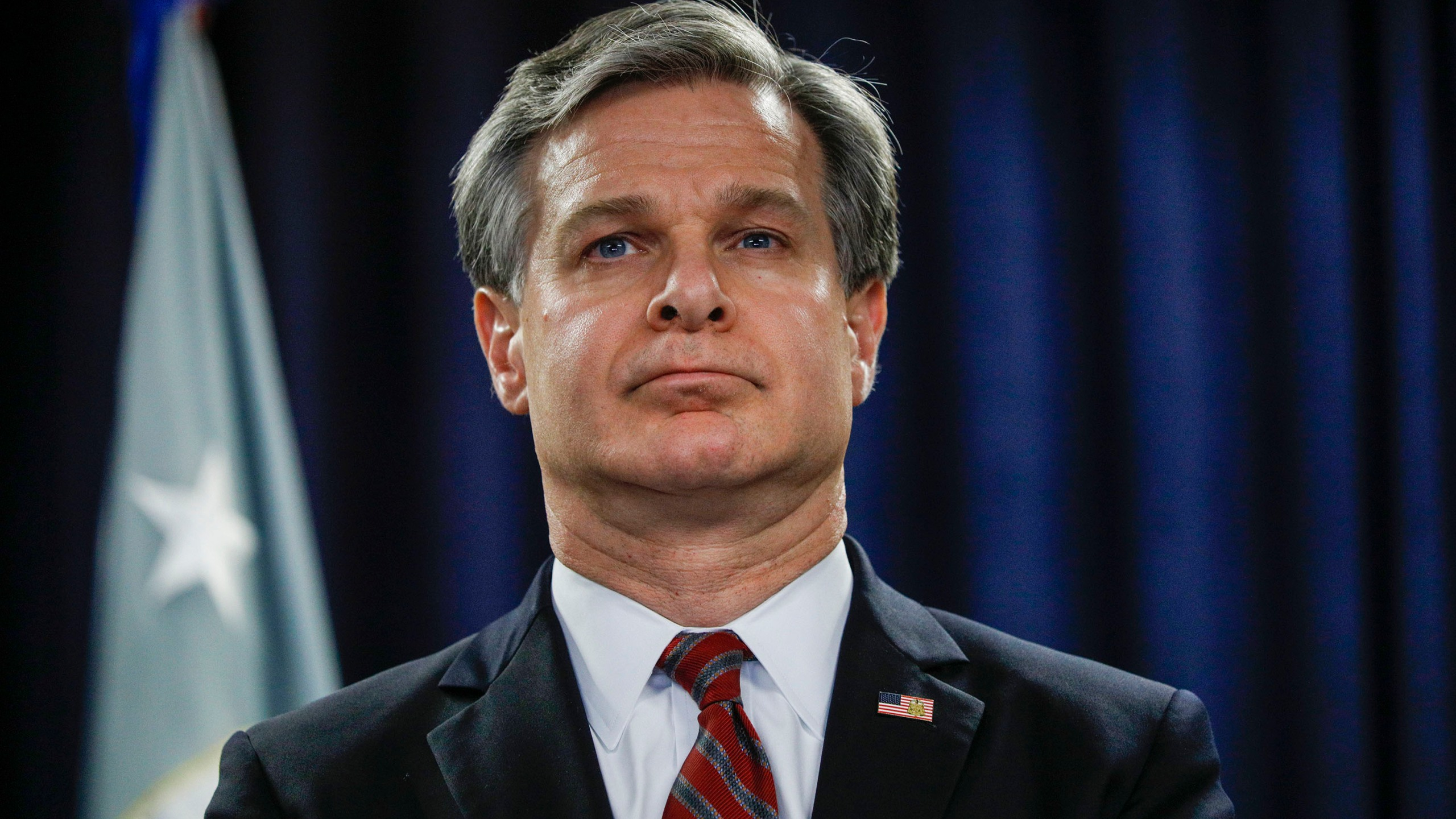 FBI Director Christopher Wray waits to speak at a news conference in Detroit on Dec. 18, 2019. (Bill Pugliano/Getty Images)