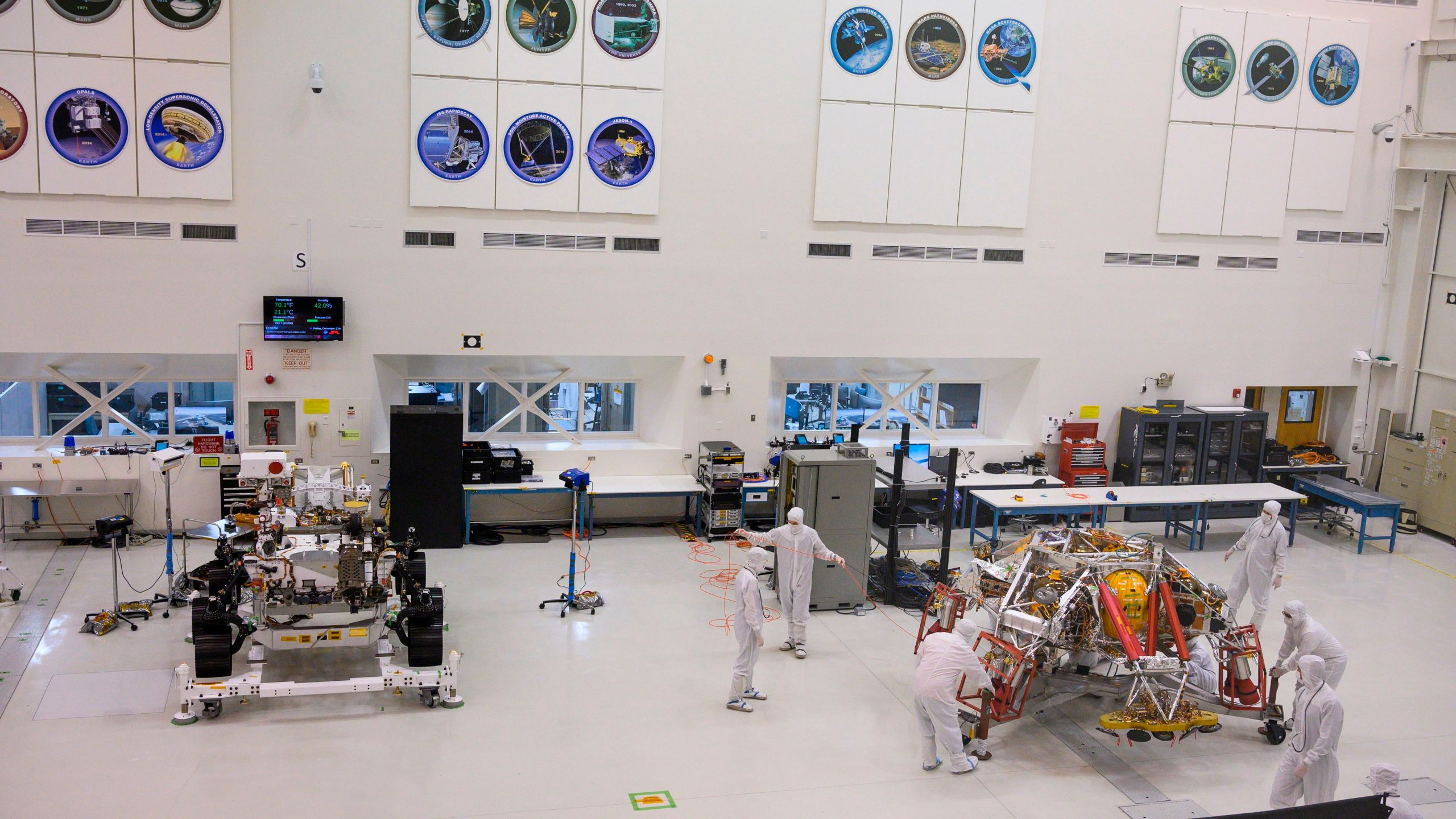 NASA engineers and technicians move the Mars 2020 spacecraft descent stage on Dec. 27, 2019, during a media tour of the spacecraft assembly area clean room at NASA's Jet Propulsion Laboratory in Pasadena. (ROBYN BECK/AFP via Getty Images)
