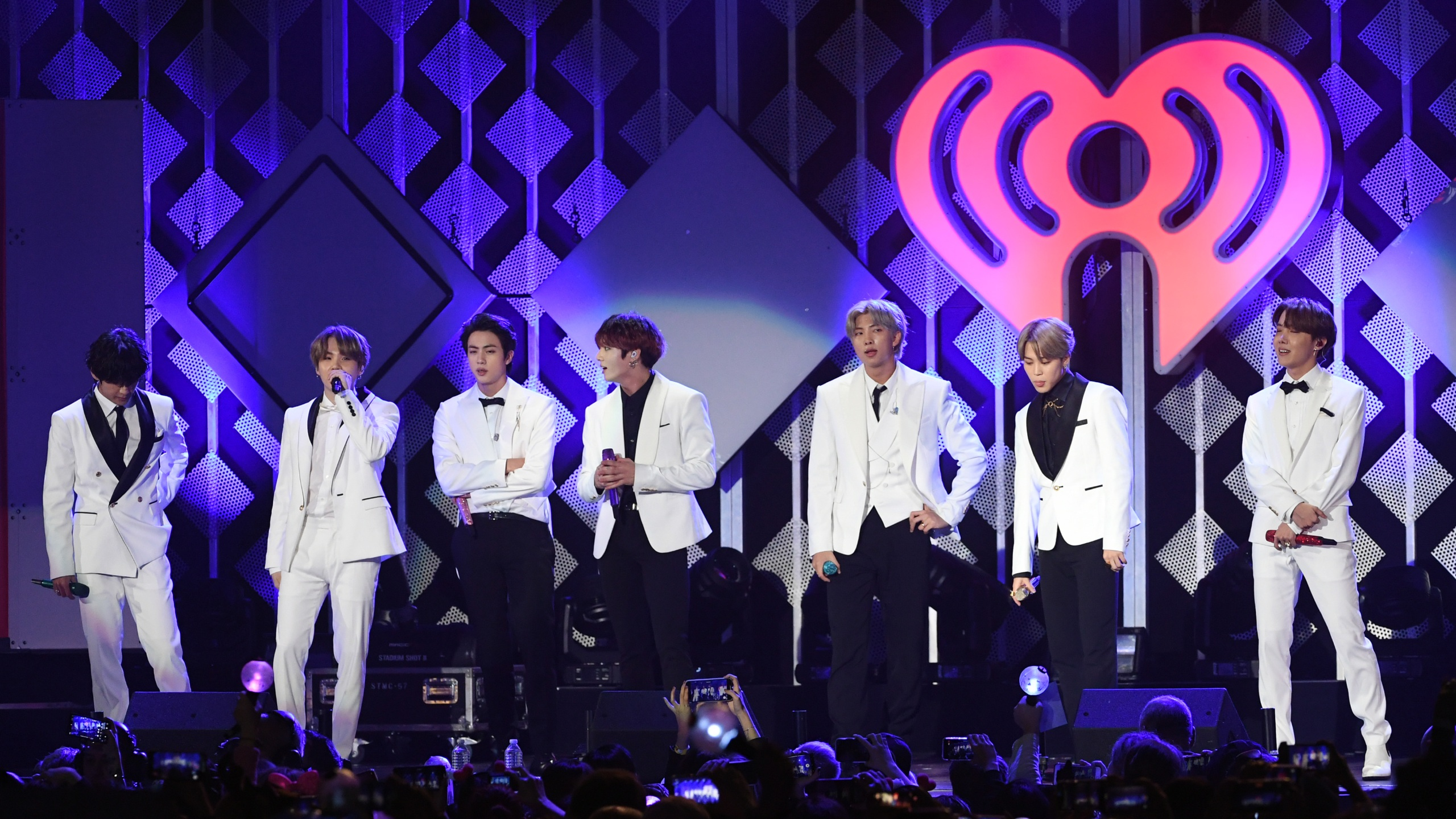 From left: V, Suga, Jin, Jungkook, RM, Jimin, and J-Hope of BTS perform onstage during 102.7 KIIS FM's Jingle Ball 2019 at the Forum on Dec. 6, 2019. (Kevin Winter/Getty Images for iHeartMedia)