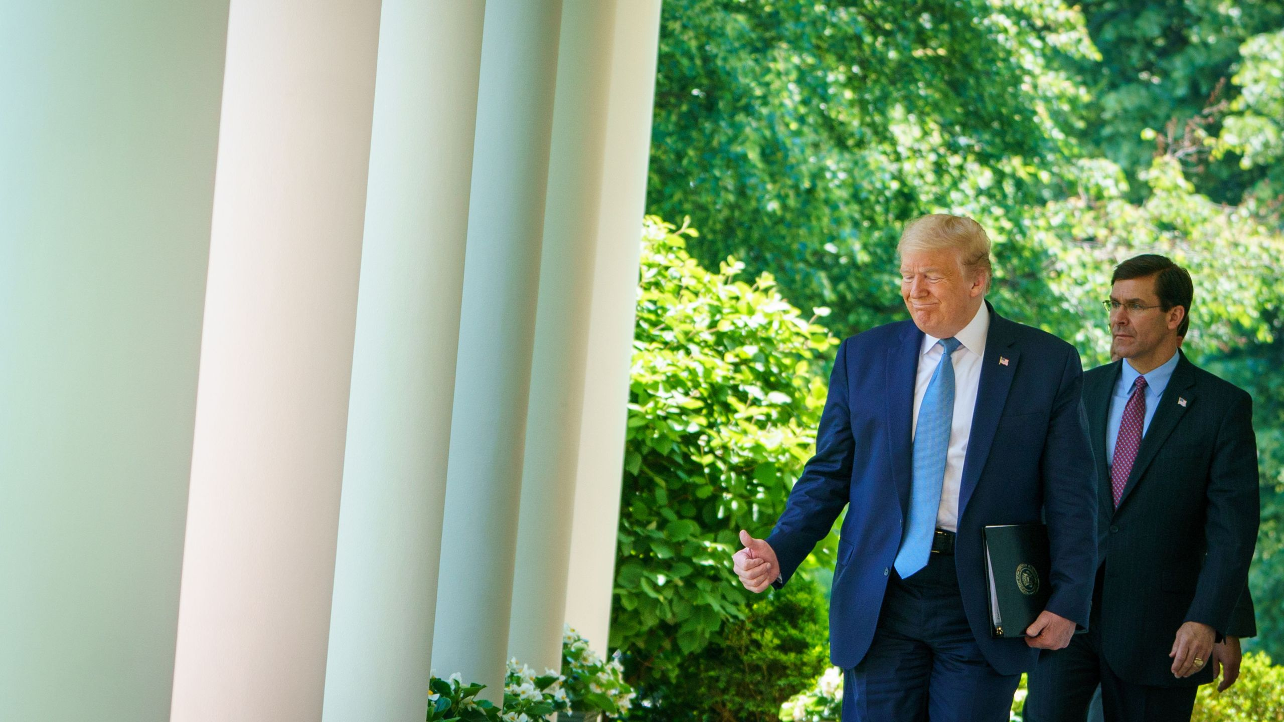 Donald Trump walks with Defense Secretary Mark Esper through the Colonnades at the White House in Washington, D.C. on May 15, 2020. (MANDEL NGAN/AFP via Getty Images)