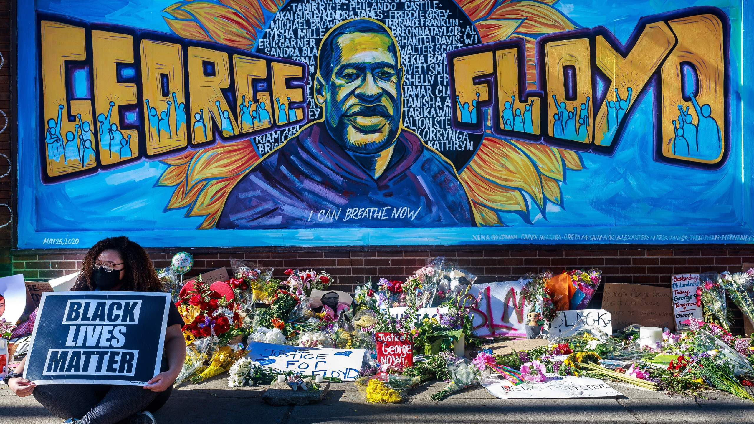 Flowers, signs and balloons are left near a makeshift memorial to George Floyd near the spot where he died while in custody of the Minneapolis police, on May 29, 2020 in Minneapolis, Minnesota. (KEREM YUCEL/AFP via Getty Images)