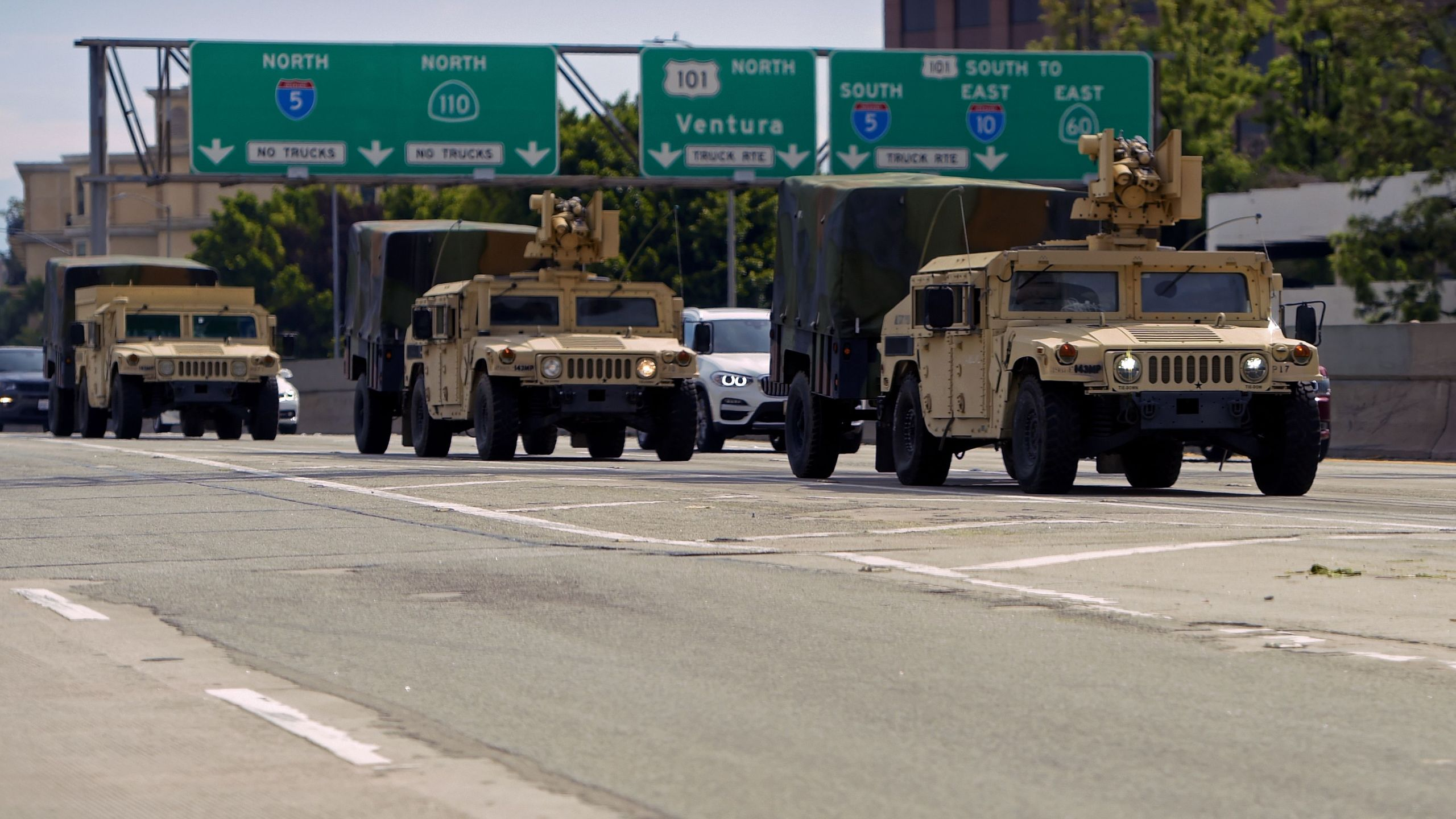 California National Guard armed vehicles are seen on the freeway as they patrol after demonstrators protested the death of George Floyd in Los Angeles on May 31, 2020. (Agustin Paullier / AFP / Getty Images)
