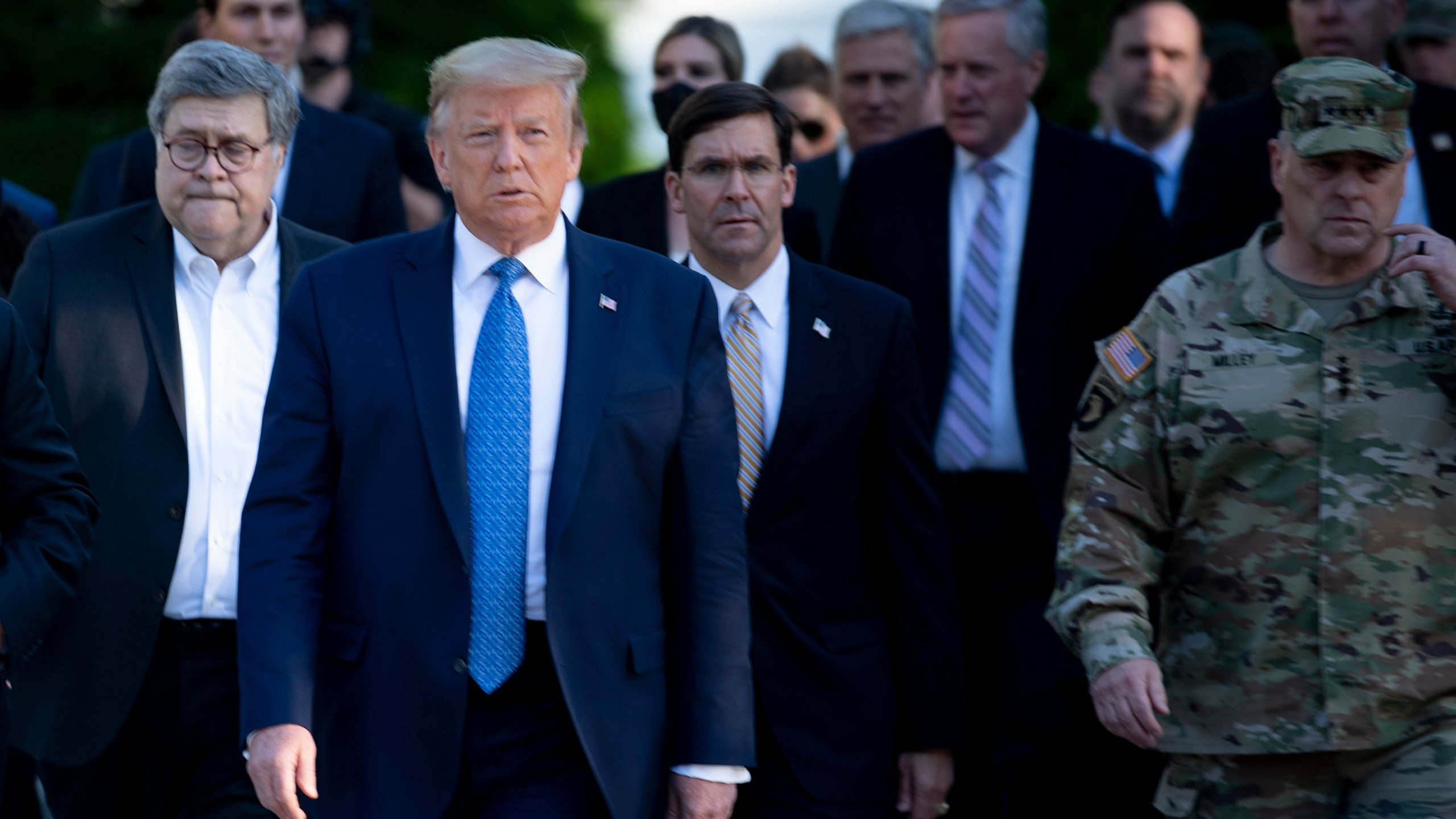 President Donald Trump walks with US Attorney General William Barr (L), US Secretary of Defense Mark T. Esper (C), Chairman of the Joint Chiefs of Staff Mark A. Milley (R), and others from the White House to visit St. John's Church after the area was cleared of people protesting the death of George Floyd June 1, 2020, in Washington, D.C. (BRENDAN SMIALOWSKI/AFP via Getty Images)