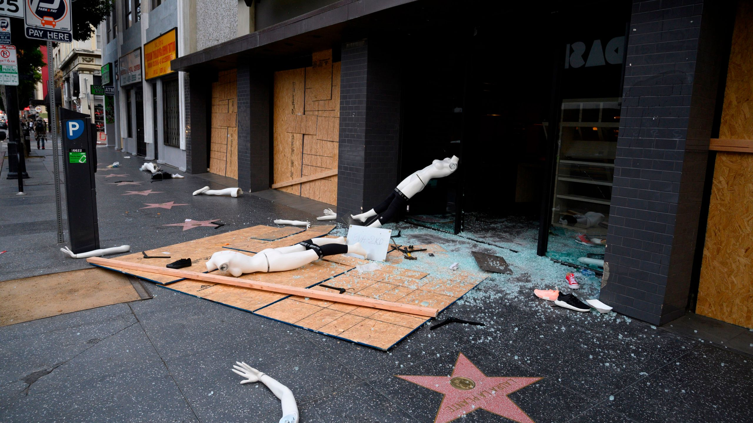 A mannequin is seen on the street after a store was broken into in Hollywood on June 1, 2020, after a third day of protests in California. (Robyn Beck / AFP / Getty Images)