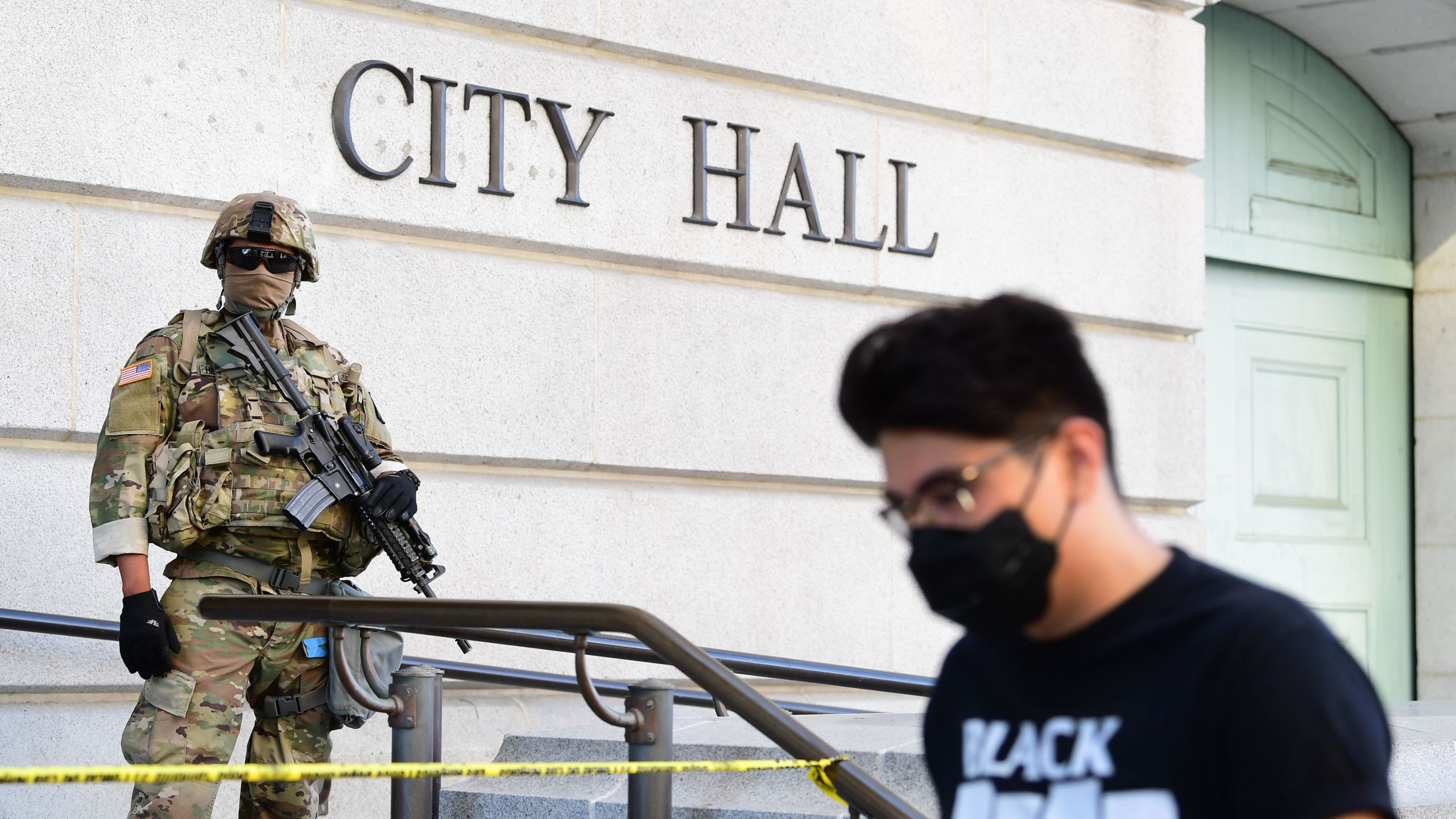 An armed National Guard mans his position in front of Los Angeles City Hall as people protest the death of George Floyd, who died in police custody, on June 3, 2020. (FREDERIC J. BROWN/AFP via Getty Images)