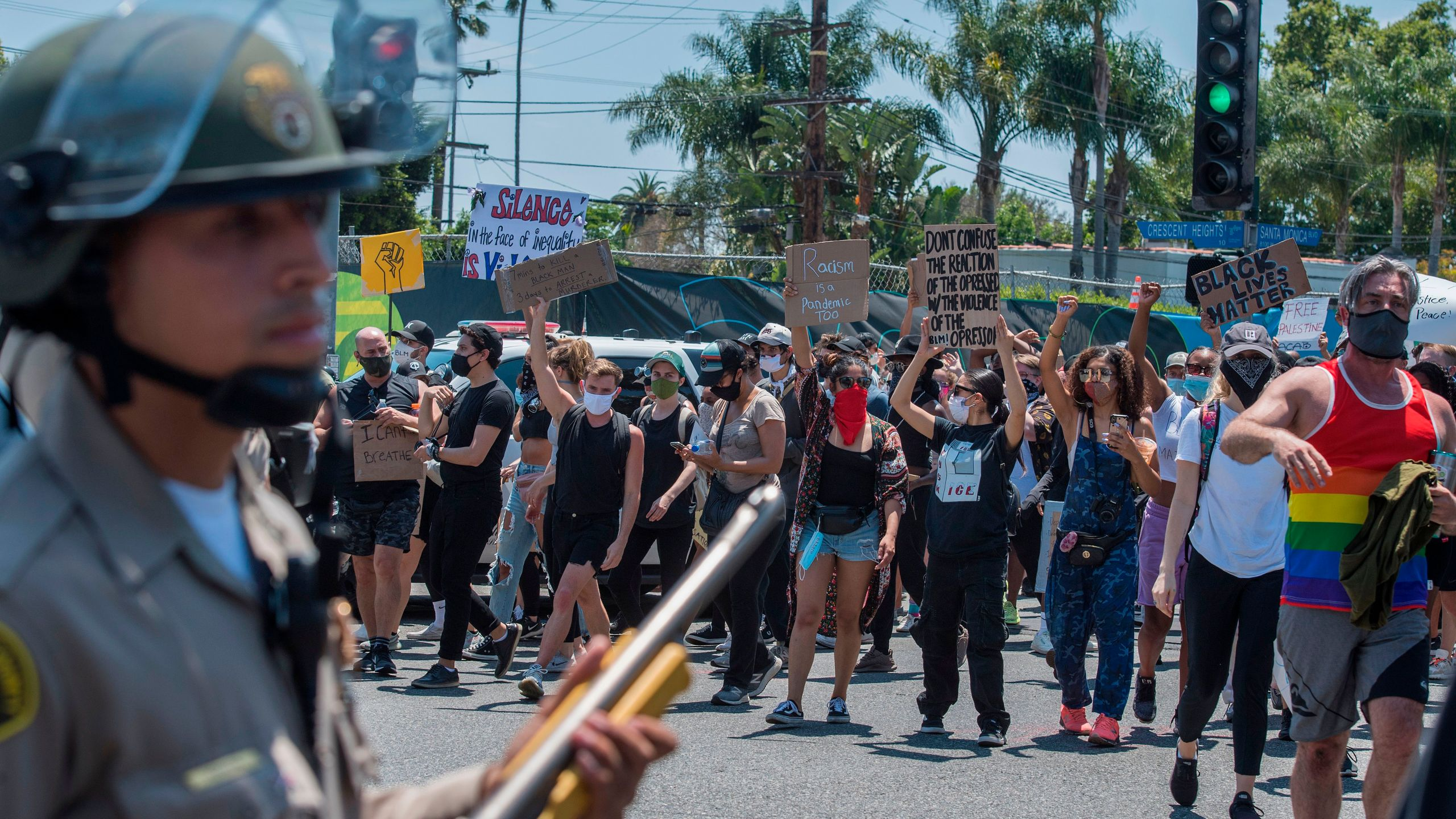 Deputies from the Los Angeles County Sheriff's Department keep watch as demonstrators continue to protest the death of George Floyd in West Hollywood on June 3, 2020. (Mark Ralston / AFP / Getty Images)