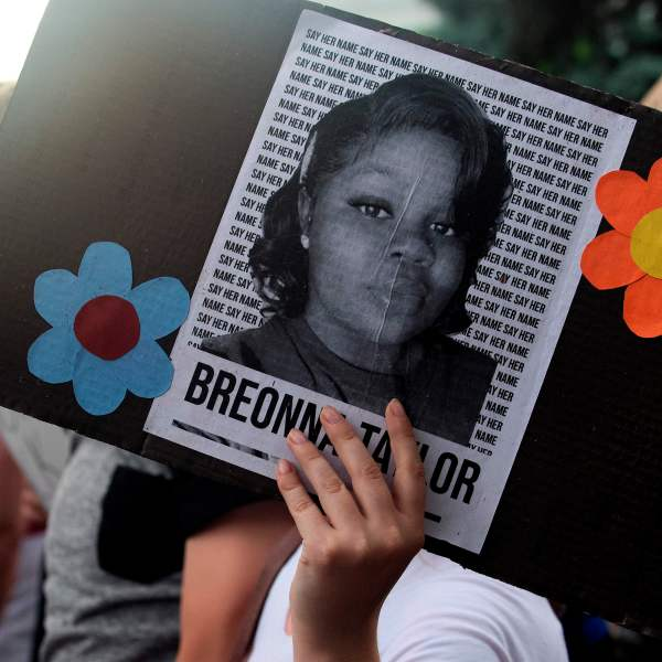 A demonstrator holds a sign with the image of Breonna Taylor, a black woman who was fatally shot by Louisville Metro Police Department officers, during a protest against the death George Floyd in Denver, Colorado on June 3, 2020. JASON CONNOLLY/AFP via Getty Images)