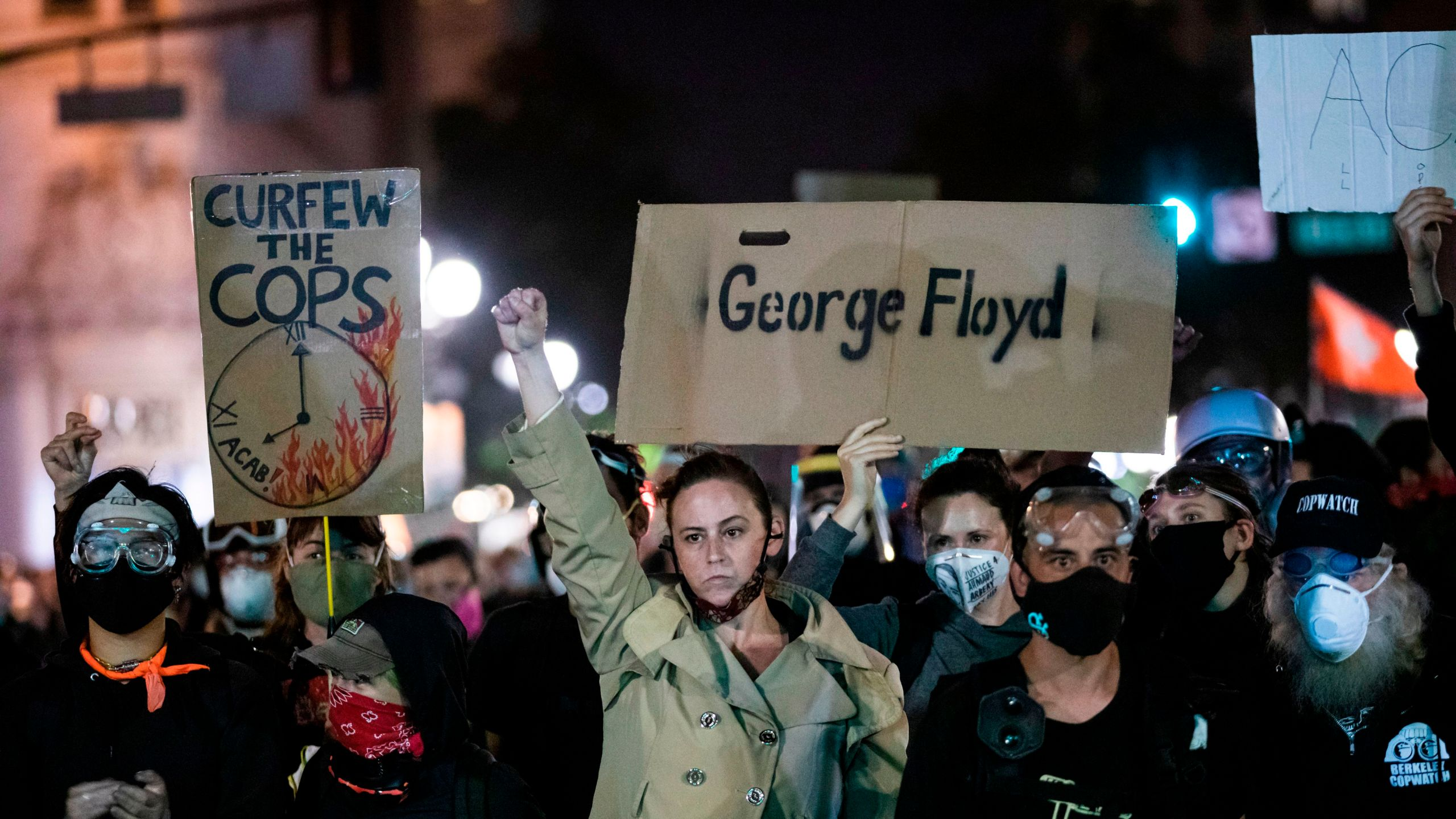 """Demonstrators attend a """"Sit Out the Curfew"""" protest against the death of George Floyd who died on May 25 in Minneapolis whilst in police custody, along a street in Oakland, California on June 3, 2020. (PHILIP PACHECO/AFP via Getty Images)"""