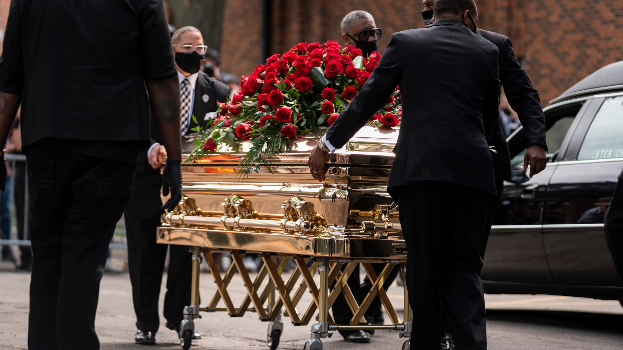 George Floyd's casket is wheeled to a hearse after a memorial service at North Central University on June 4, 2020 in Minneapolis, Minnesota. (Stephen Maturen/Getty Images)