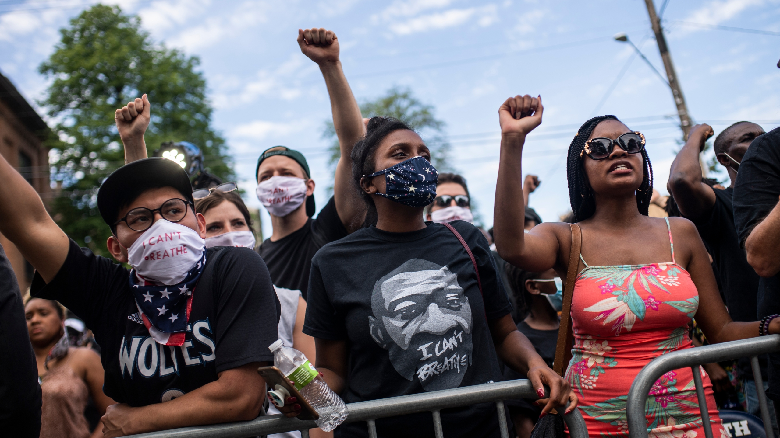 A group of people chant George Floyd's name outside a memorial service at North Central University in Minneapolis on June 4, 2020. (Stephen Maturen/Getty Images)
