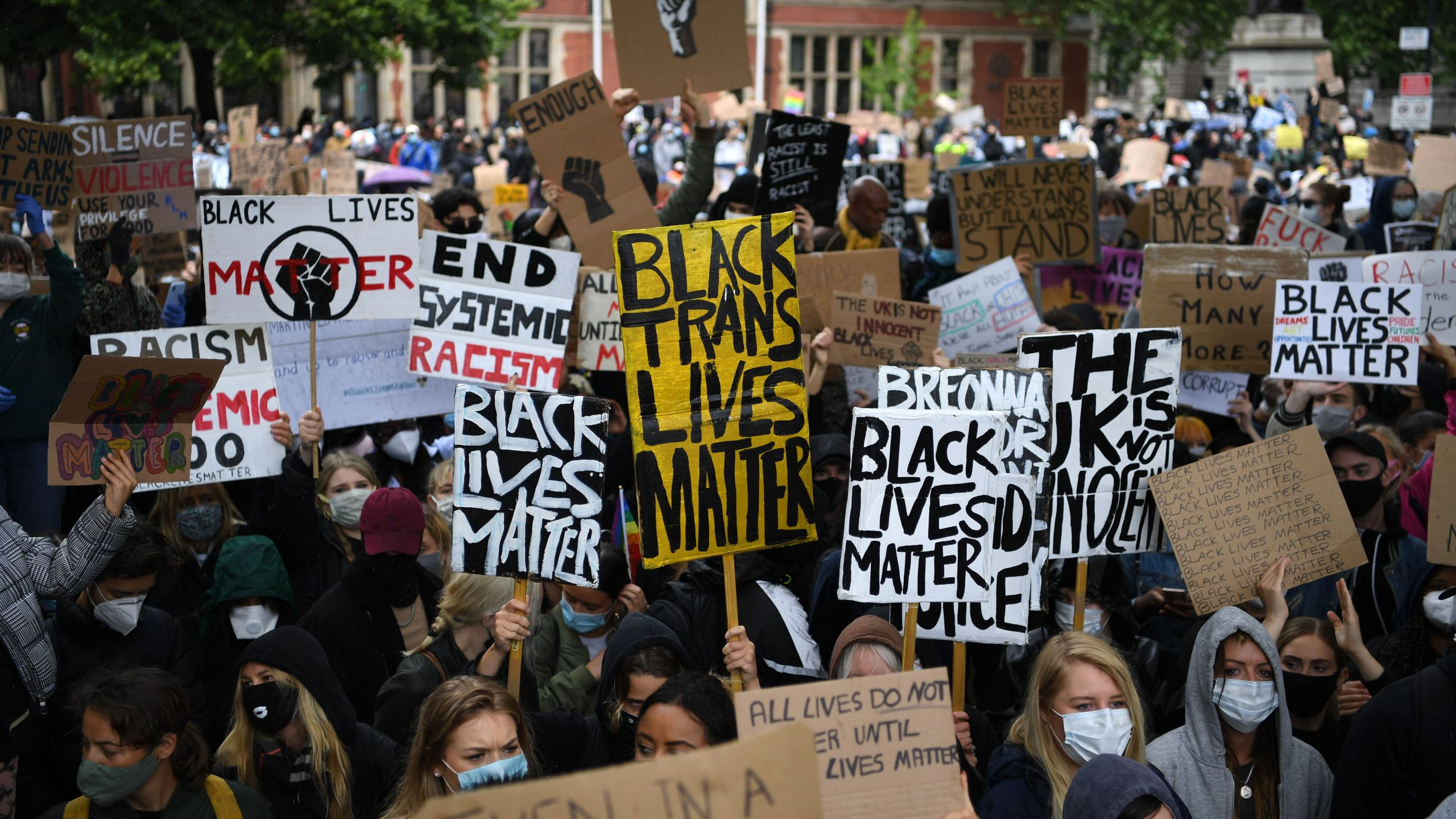 Protesters hold placards as they attend a demonstration in Parliament Square in central London on June 6, 2020, to show solidarity with the Black Lives Matter movement in the wake of the killing of George Floyd, an unarmed black man who died after a police officer knelt on his neck in Minneapolis. (DANIEL LEAL-OLIVAS / AFP via Getty Images)