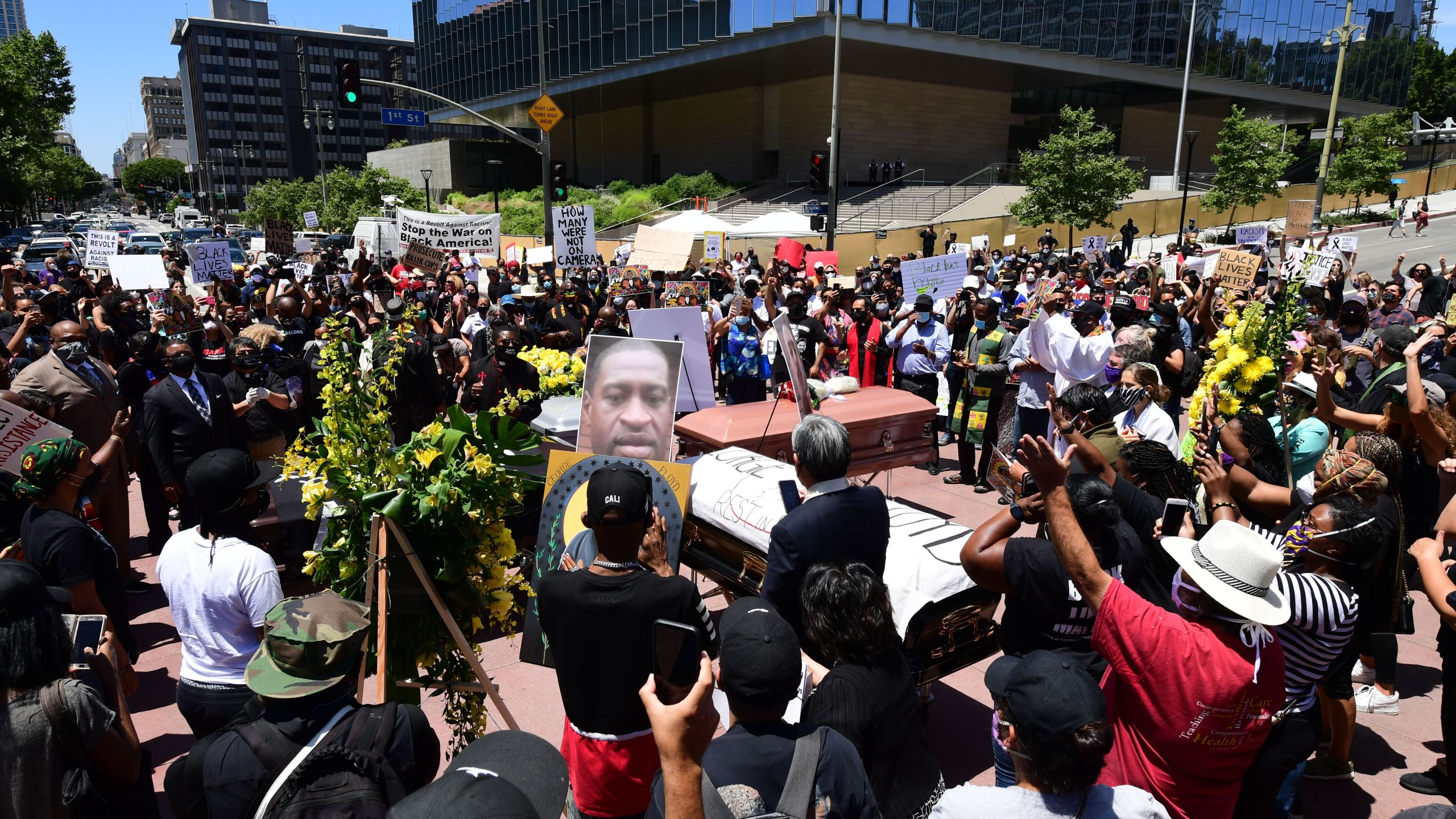Advocates hold a memorial service honoring George Floyd in downtown Los Angeles on June 8, 2020. (FREDERIC J. BROWN/AFP via Getty Images)