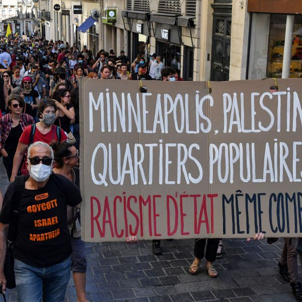 Protestors march with placards during a demonstration on June 13, 2020, in Montpellier, in the south of France, as part of the 'Black Lives Matter' worldwide protests against racism and police brutality. (PASCAL GUYOT/AFP via Getty Images)