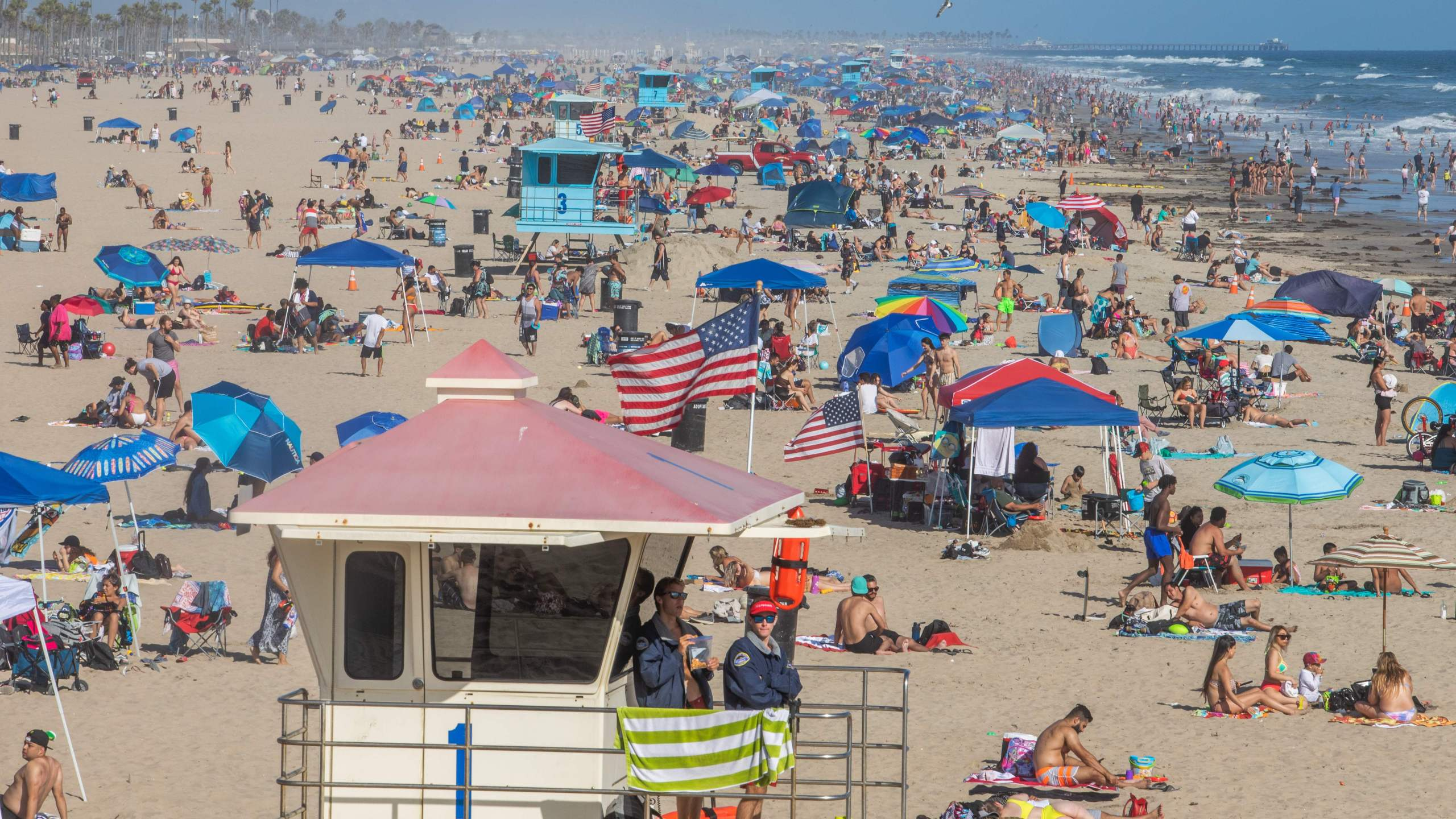 People enjoy the beach amid the coronavirus pandemic in Huntington Beach, on June 14, 2020. (Apu GOMES / AFP) (Photo by APU GOMES/AFP via Getty Images)