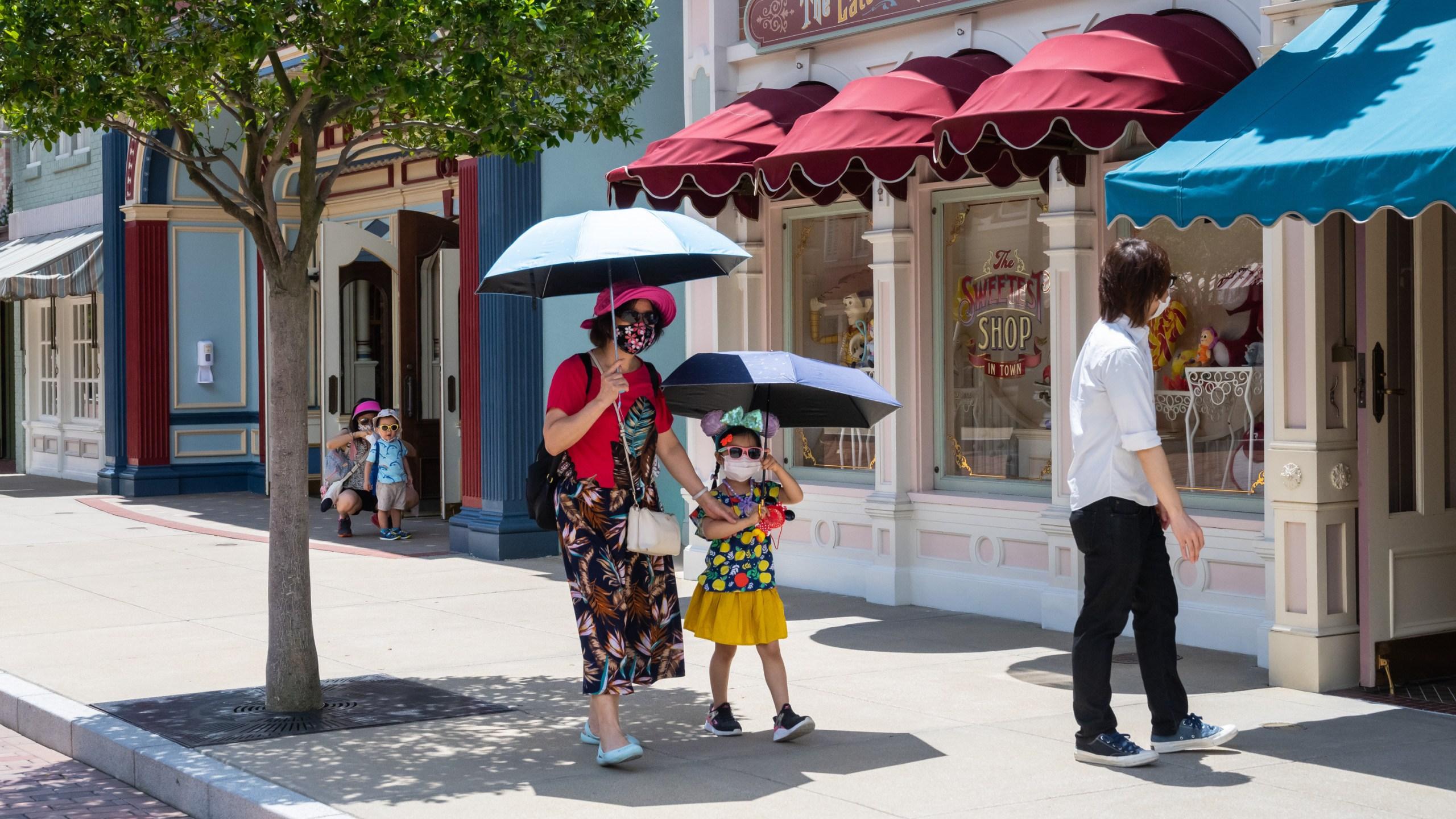 Visitors walk in Walt Disney Co.'s Disneyland Resort on June 18, 2020 ,in Hong Kong, China. (Billy H.C. Kwok/Getty Images)