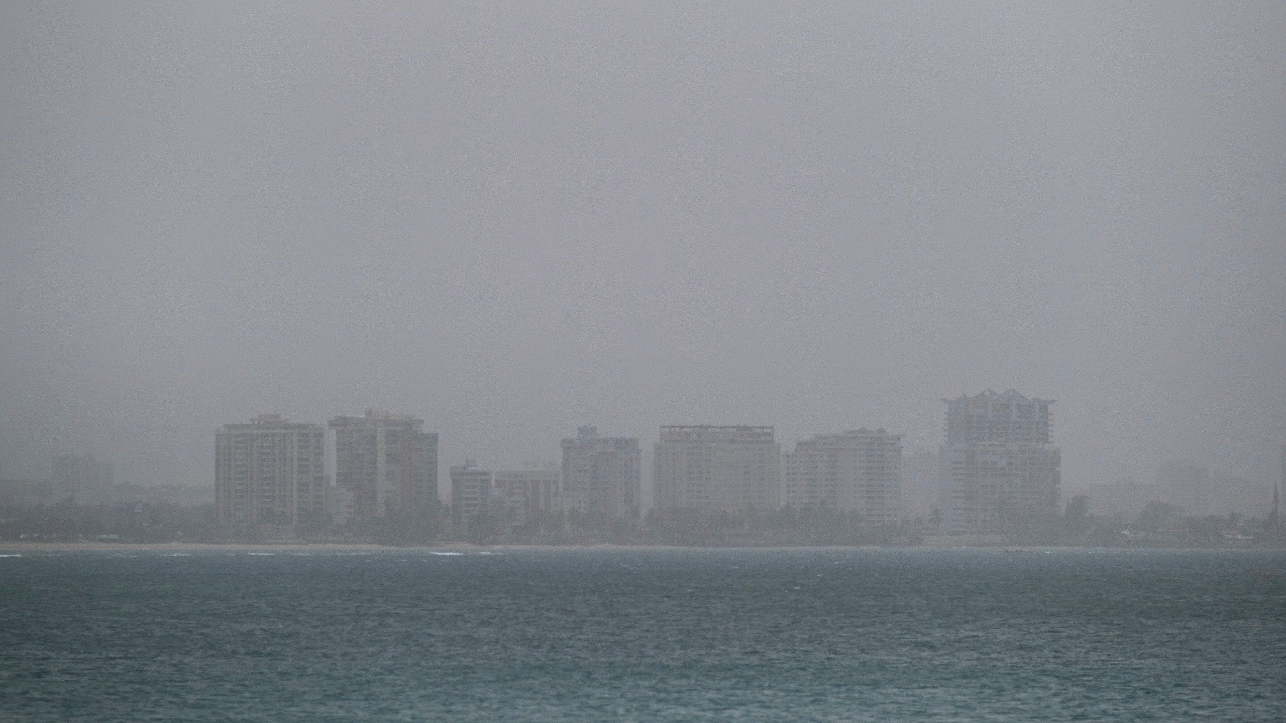A vast cloud of Sahara dust is blanketing the city of San Juan, Puerto Rico, on June 22, 2020. (RICARDO ARDUENGO/AFP via Getty Images)