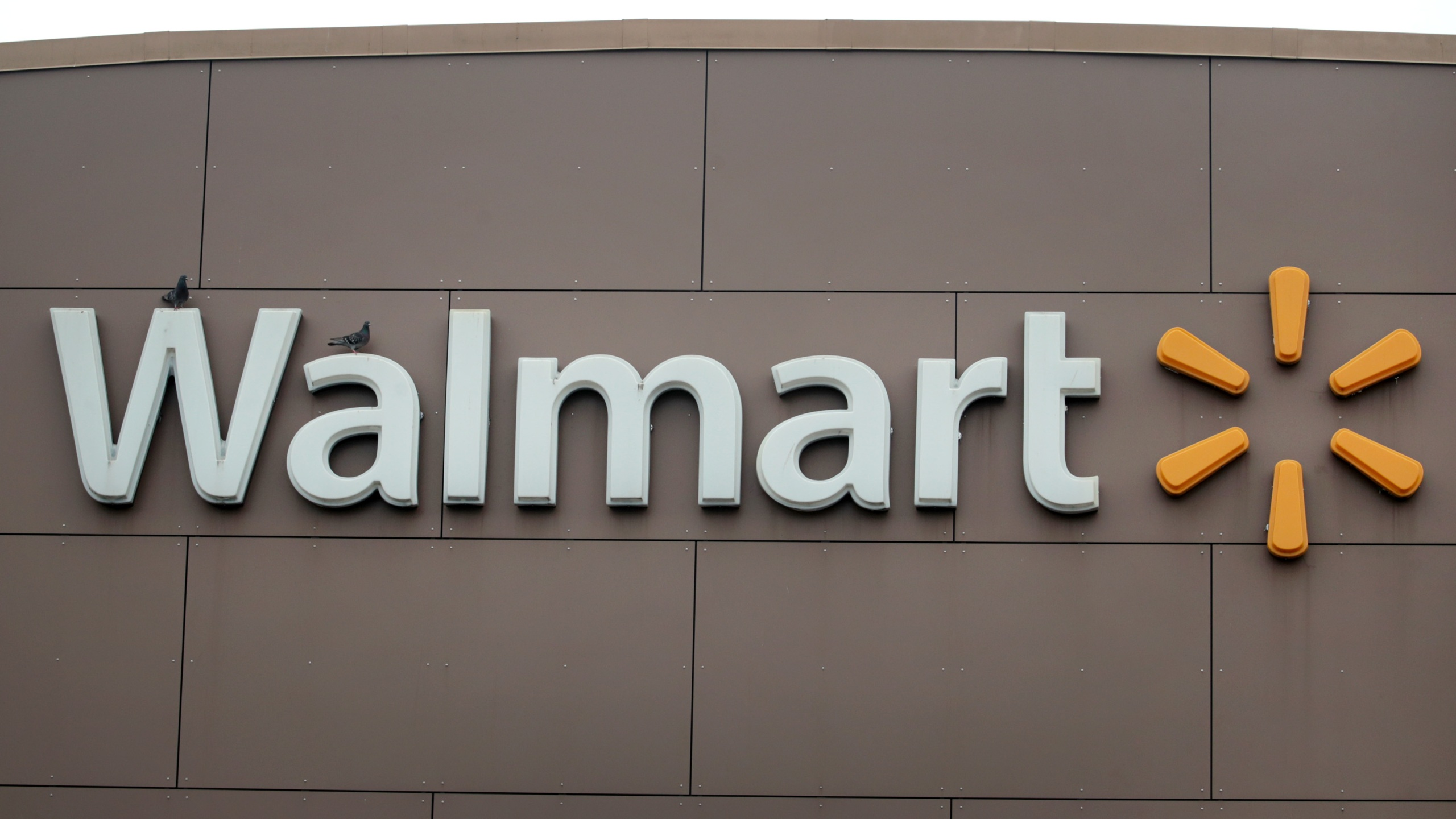 A sign hangs outside of a Walmart store on May 19, 2020 in Chicago, Illinois. (Scott Olson/Getty Images)