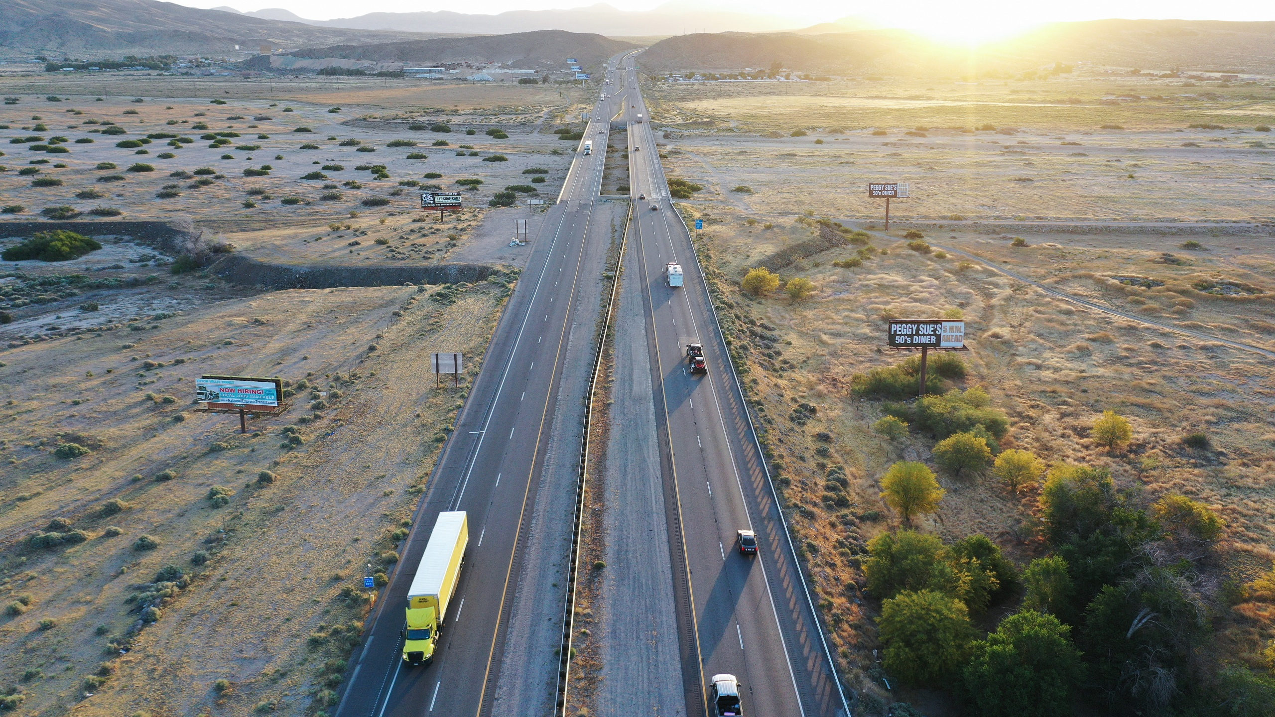 An aerial view of vehicles driving at sunrise on I-15 amid the coronavirus pandemic on May 23, 2020 in Barstow, California. (Mario Tama/Getty Images)