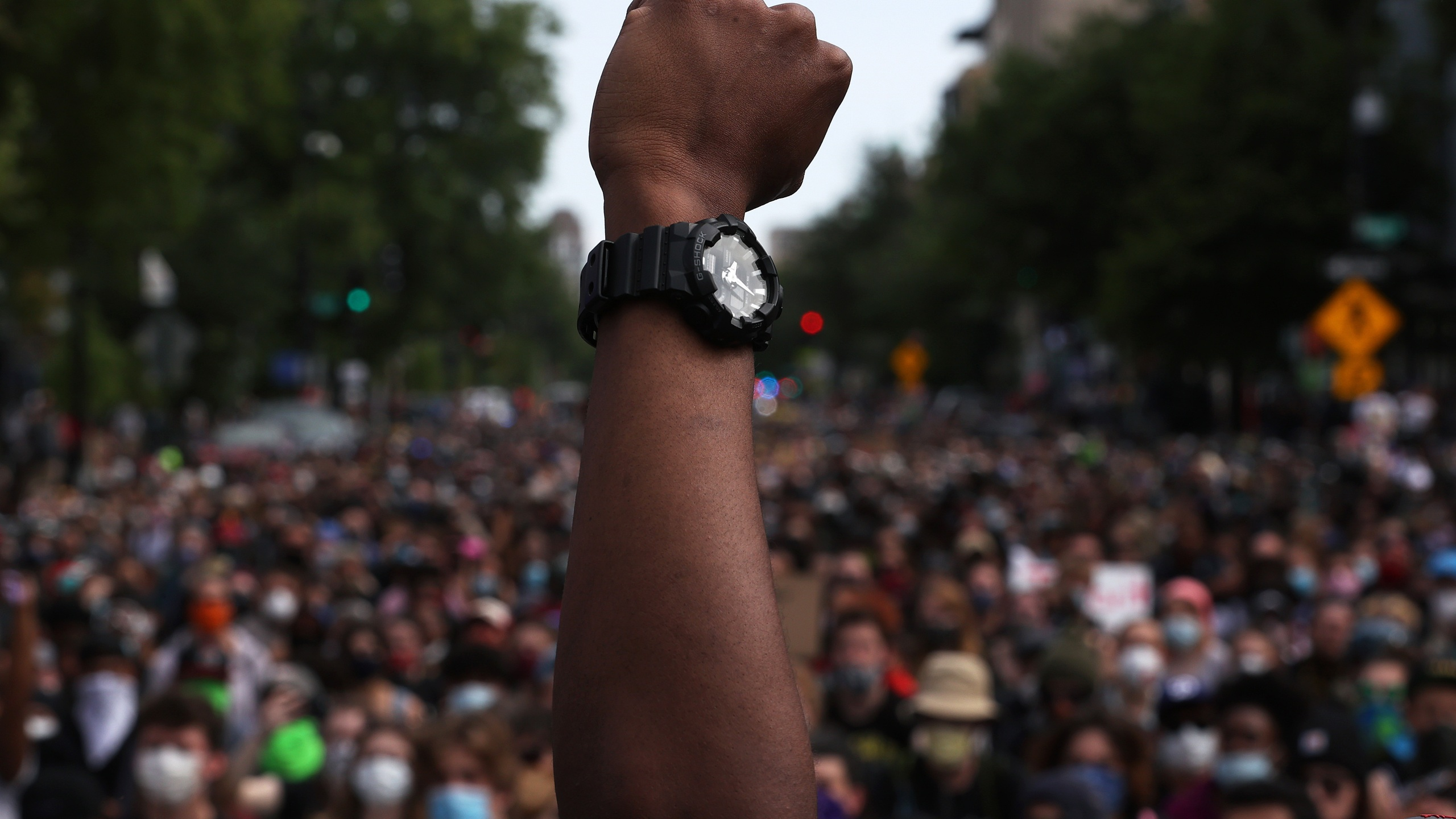 A man holds up his fist while hundreds of demonstrators march to protest against police brutality and the death of George Floyd, on June 2, 2020 in Washington, D.C. (Win McNamee/Getty Images)