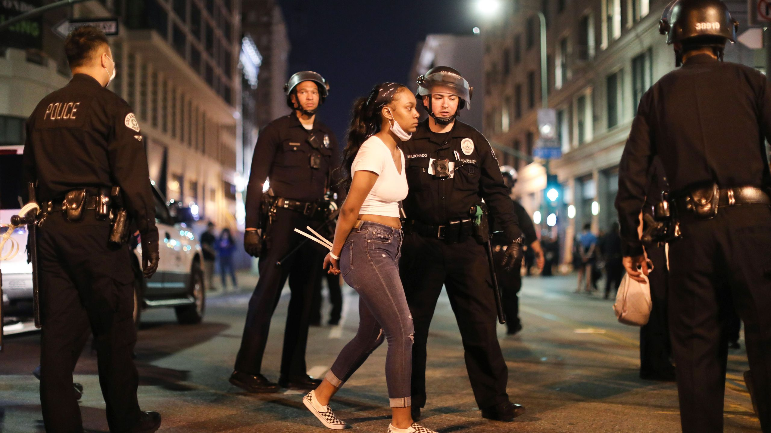A woman is arrested after curfew went into effect during mostly peaceful demonstrations over George Floyd's death in downtown Los Angeles on June 2, 2020. (Mario Tama/Getty Images)