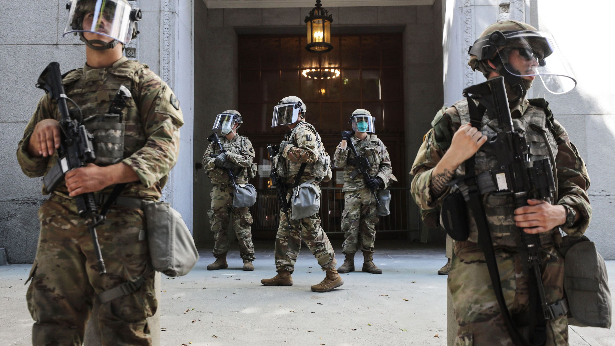 National Guard troops are posted outside the Los Angeles County District Attorney's office during a peaceful demonstration over George Floyd's death on June 3, 2020. (Mario Tama / Getty Images)