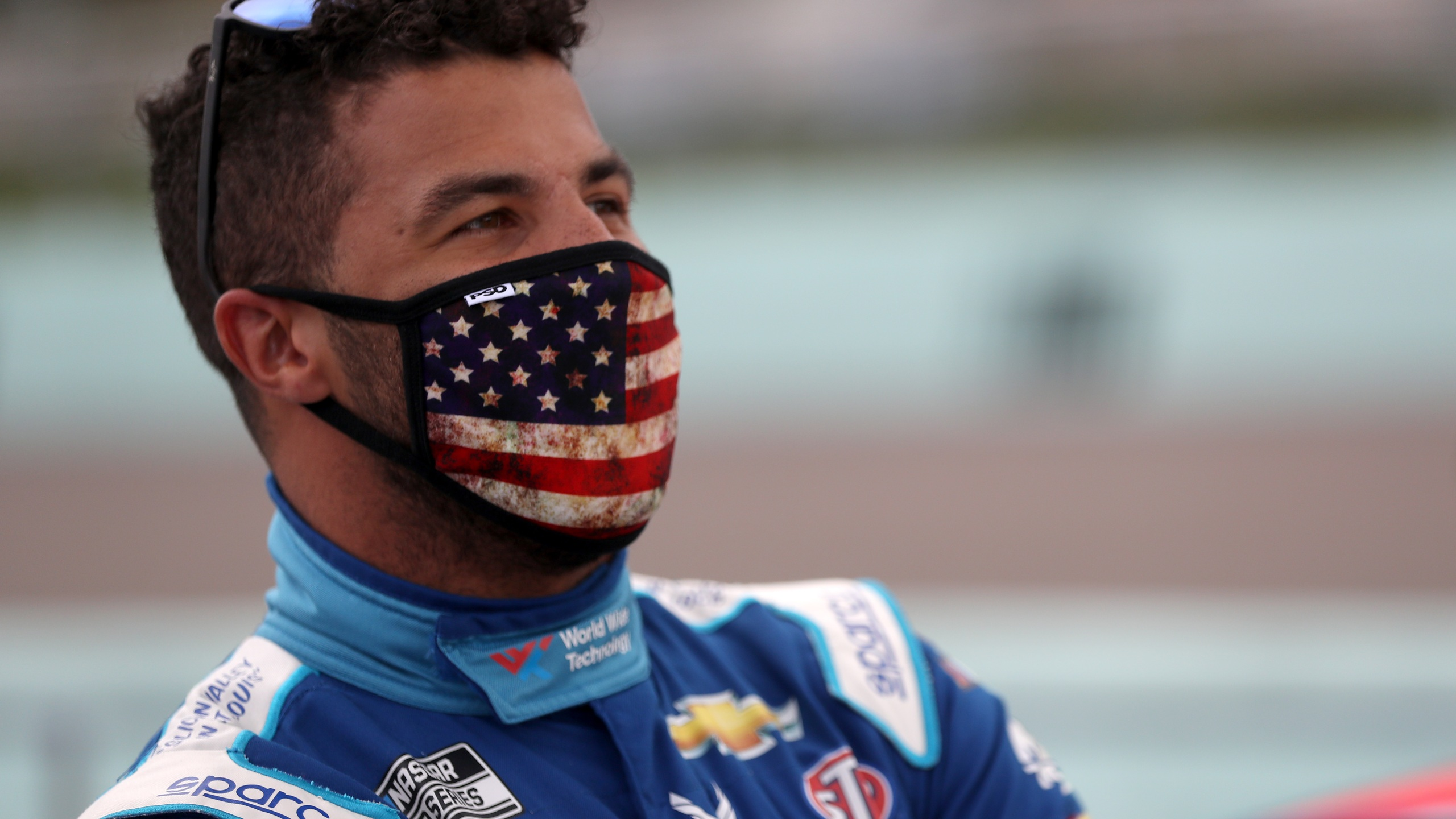 Bubba Wallace, driver of the #43 World Wide Technology Chevrolet, stands on the grid prior to the NASCAR Cup Series Dixie Vodka 400 at Homestead-Miami Speedway on June 14, 2020 ,in Homestead, Florida. (Chris Graythen/Getty Images)