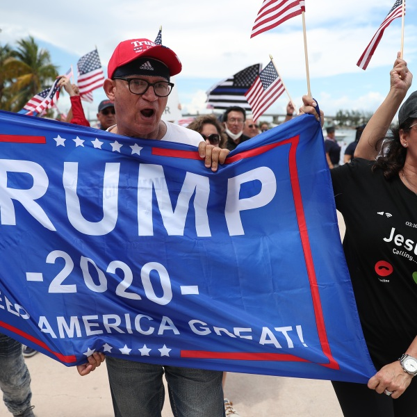 """Demonstrators take part in a """"Law and Order Rally"""" that was also supporting President Donald Trump on June 14, 2020 in Miami. (Joe Raedle/Getty Images)"""
