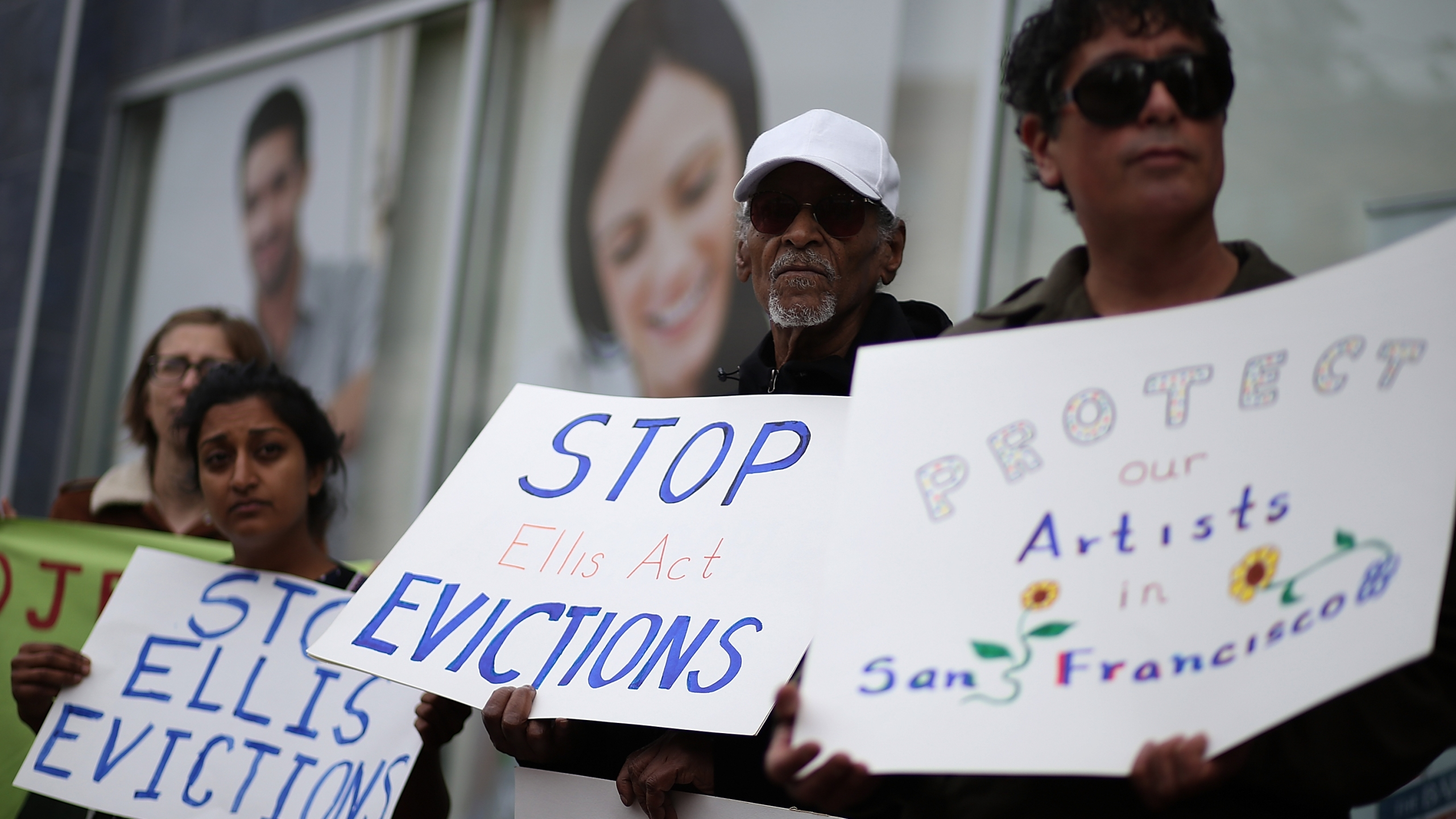 Activists and tenants stage a protest against A landlord's attempts to evict them from a San Francisco building on March 8, 2016. (Justin Sullivan/Getty Images)