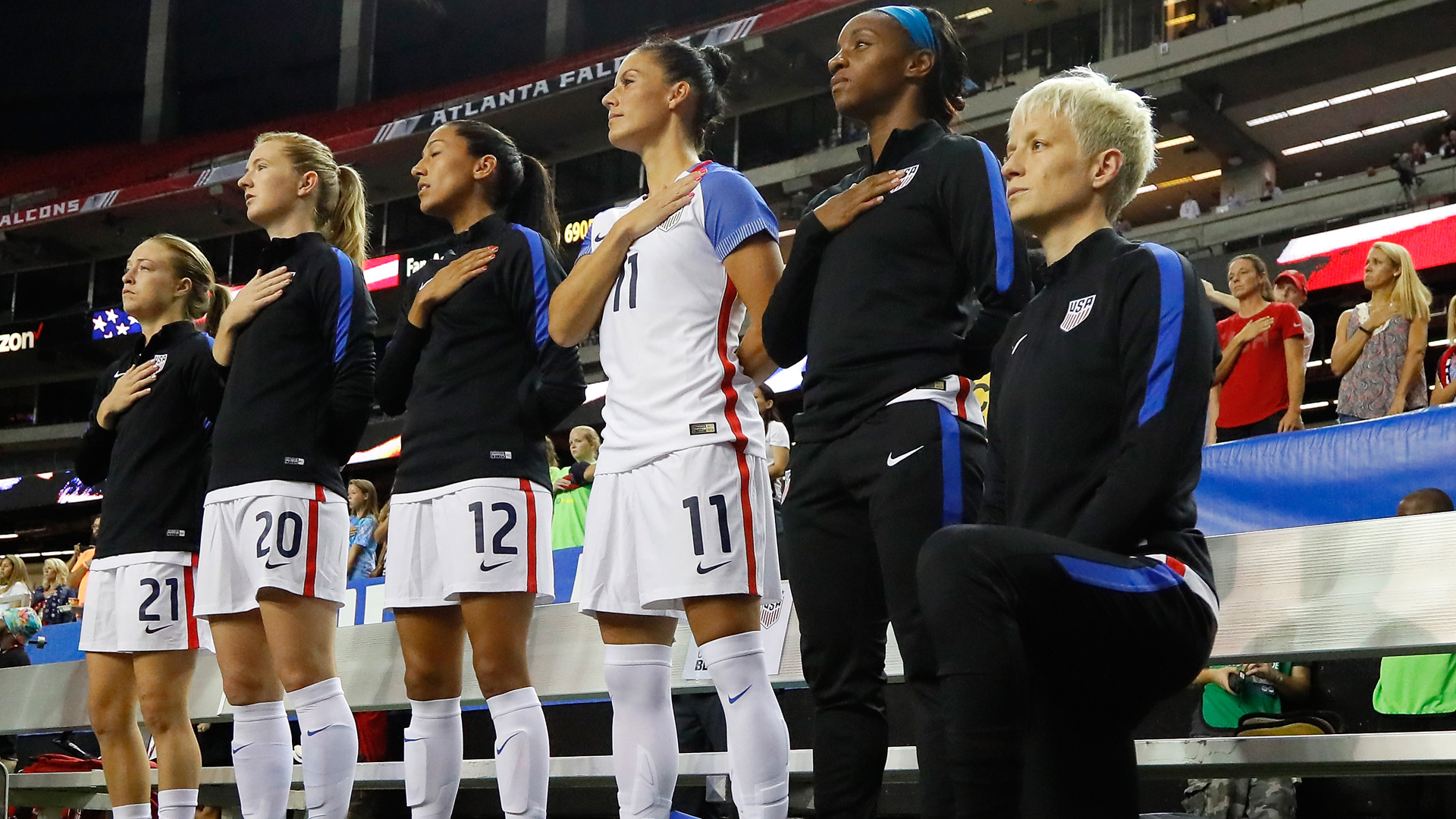 Megan Rapinoe #15 kneels during the national anthem before a match between the United States and the Netherlands at Georgia Dome on Sept. 18, 2016 in Atlanta. (Kevin C. Cox/Getty Images)